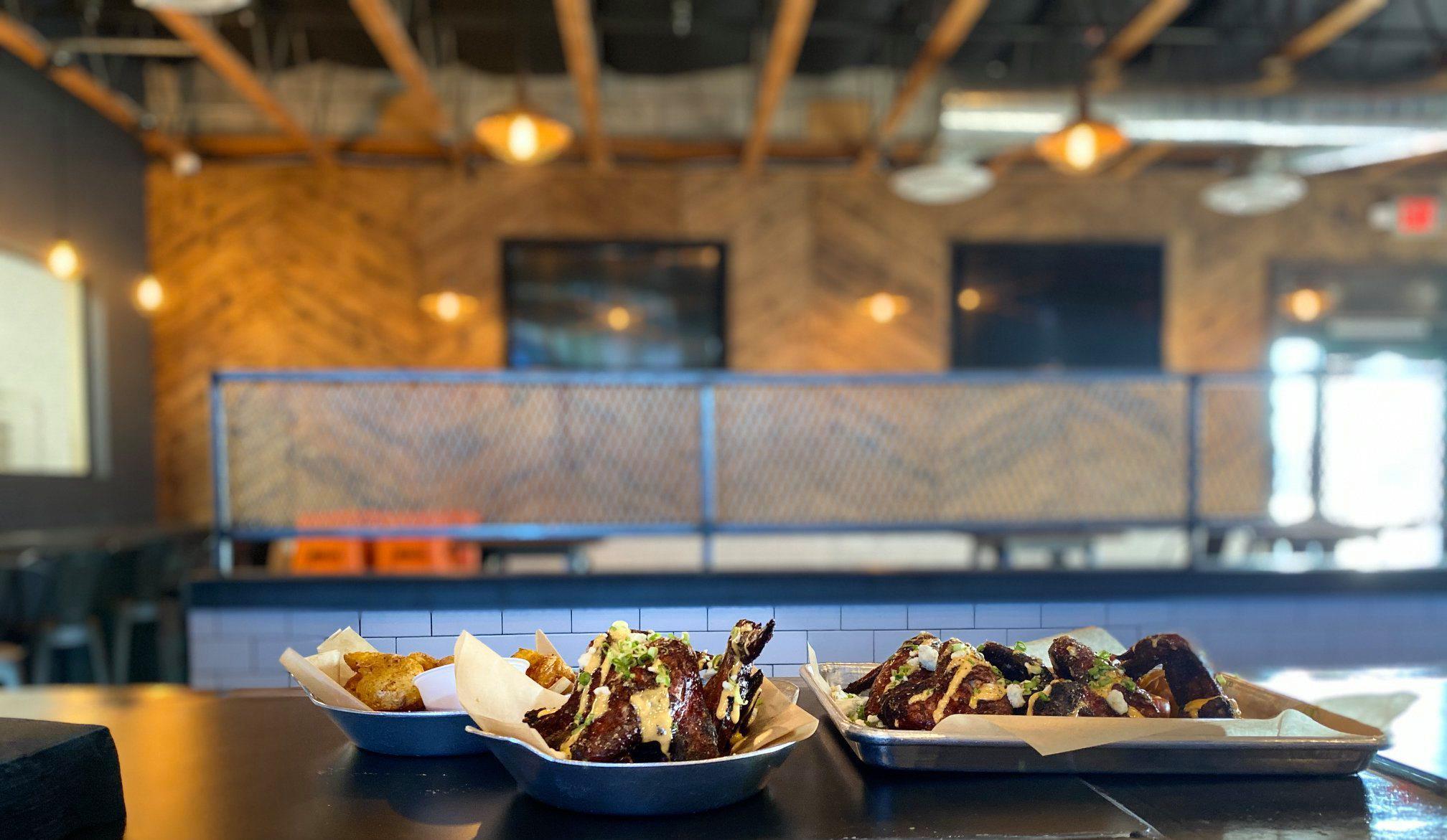 Food on plates at a bar