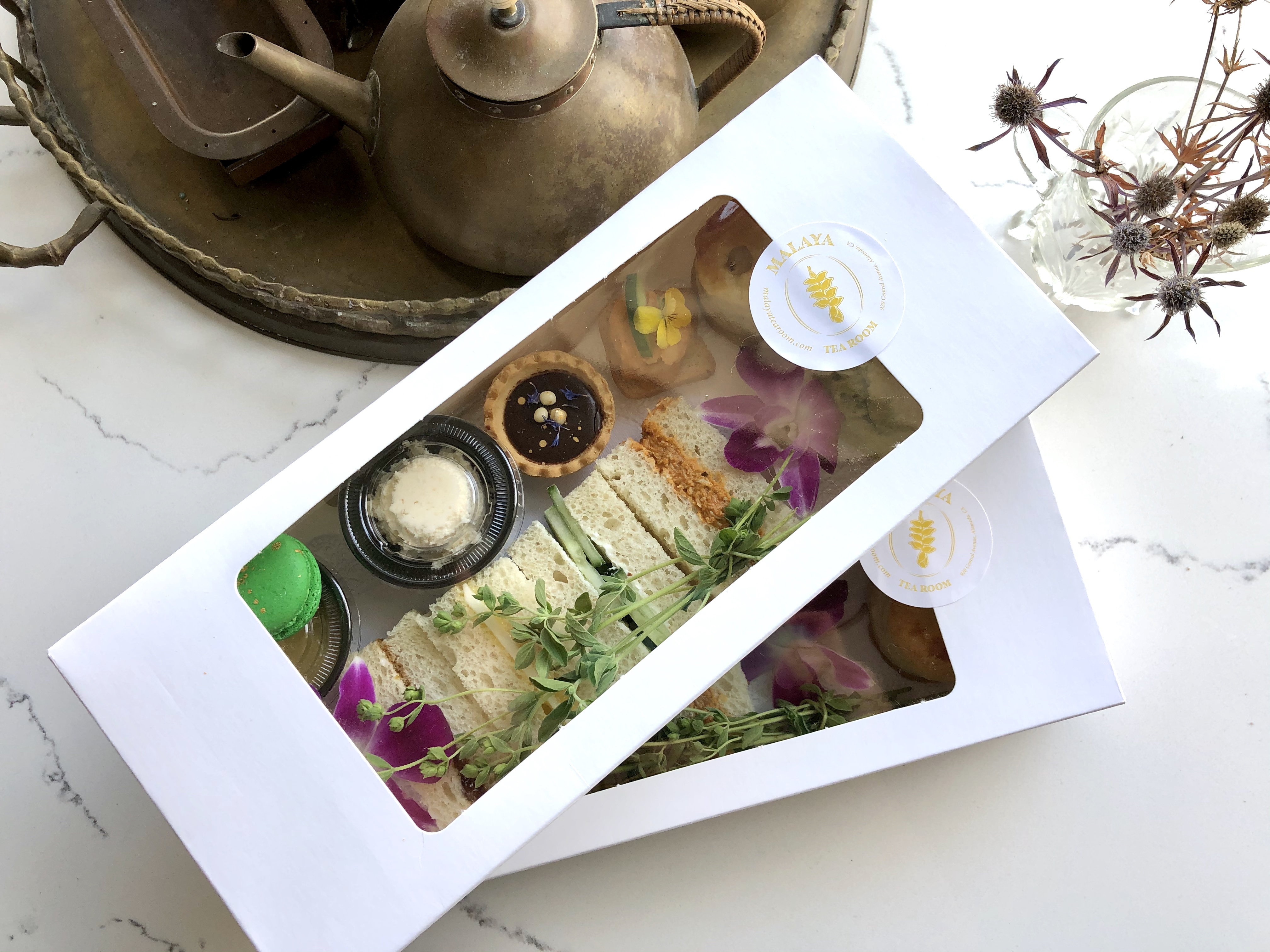 Malaya Tea Room's afternoon tea boxes packed up to go