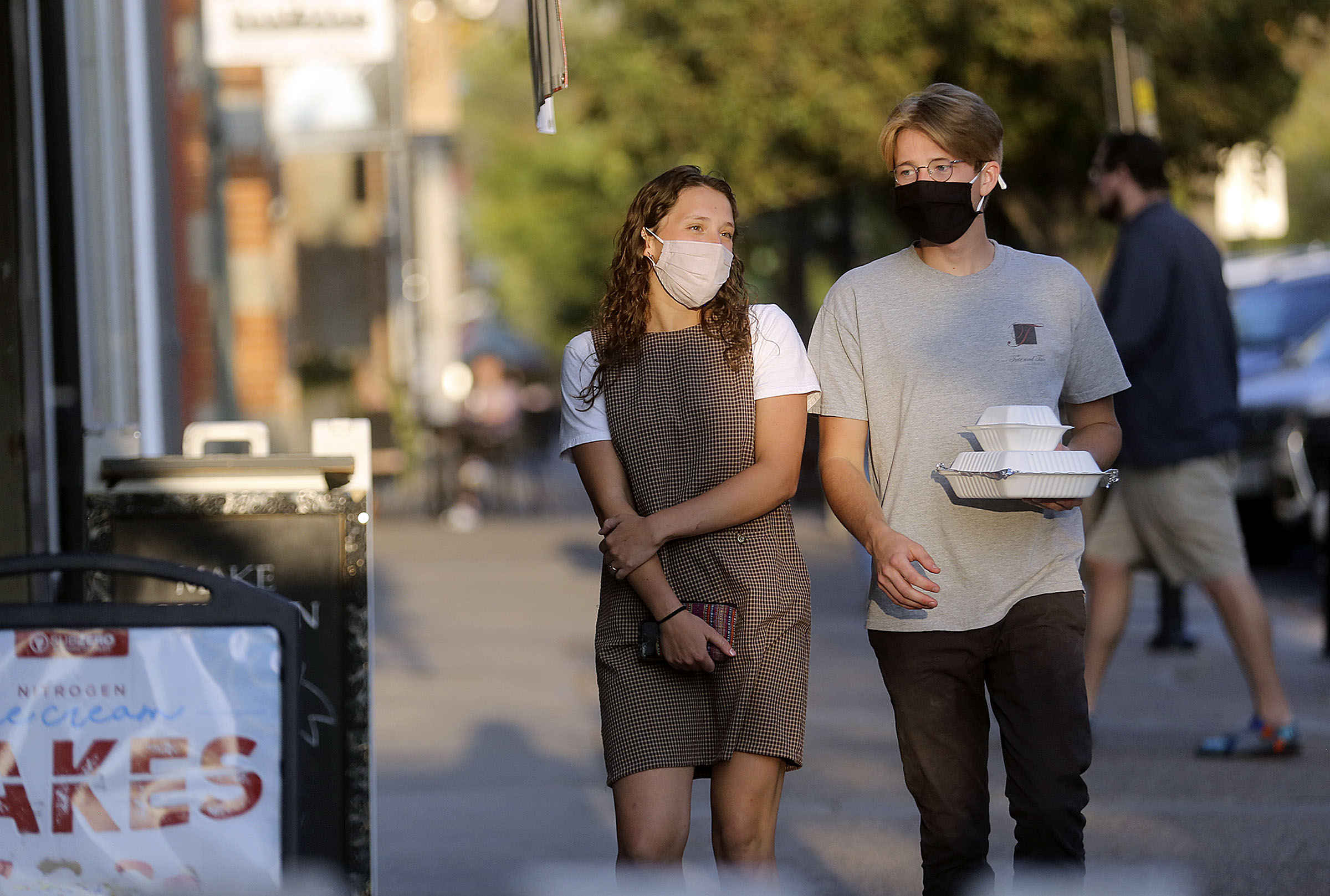 Allison Barr, 23, and Jack Barr, 24, walk through downtown Provo on Monday, Sept. 14, 2020. The majority of recent COVID-19 cases are among people between the ages 14-24, many of them living in Utah County.