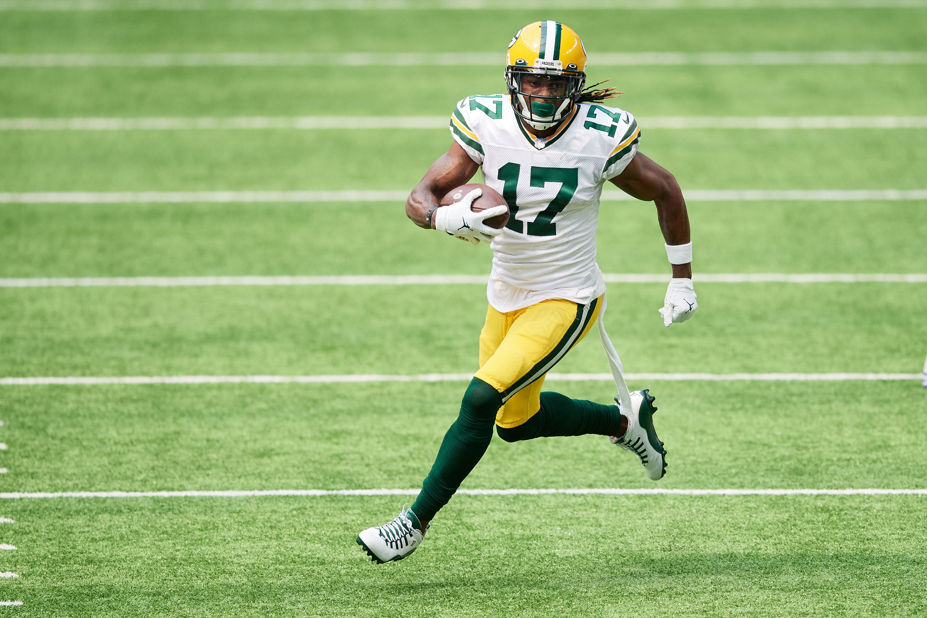 Davante Adams of the Green Bay Packers carries the ball against the Minnesota Vikings during the game at U.S. Bank Stadium on September 13, 2020 in Minneapolis, Minnesota. The Packers defeated the Vikings 43-34.