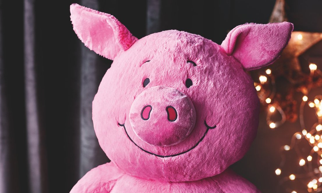 A stuffed Percy Pig toy's face, based on the Percy Pig sweet