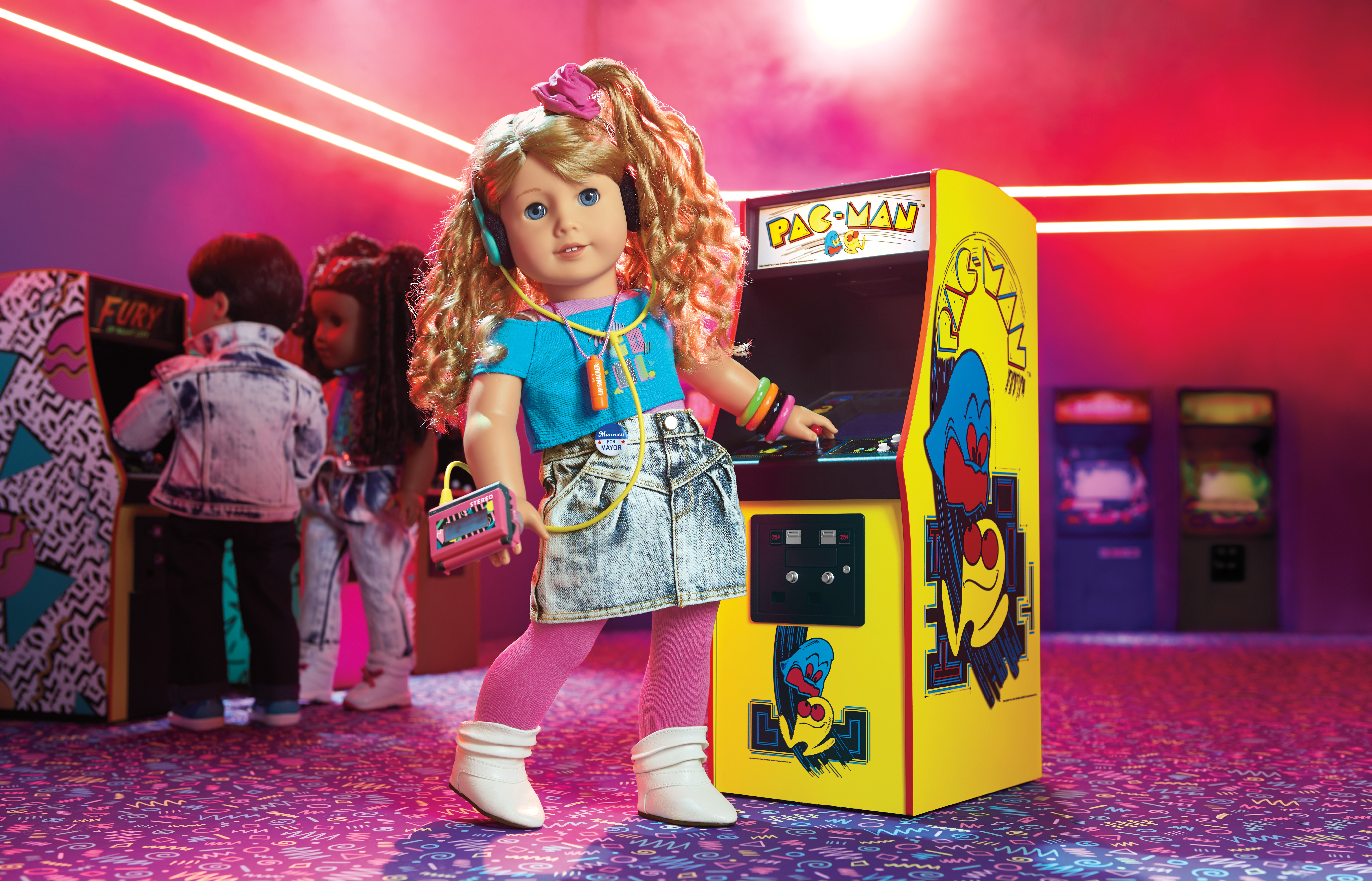 Doll dressed in an 80s outfit standing in the middle of a video arcade scene.
