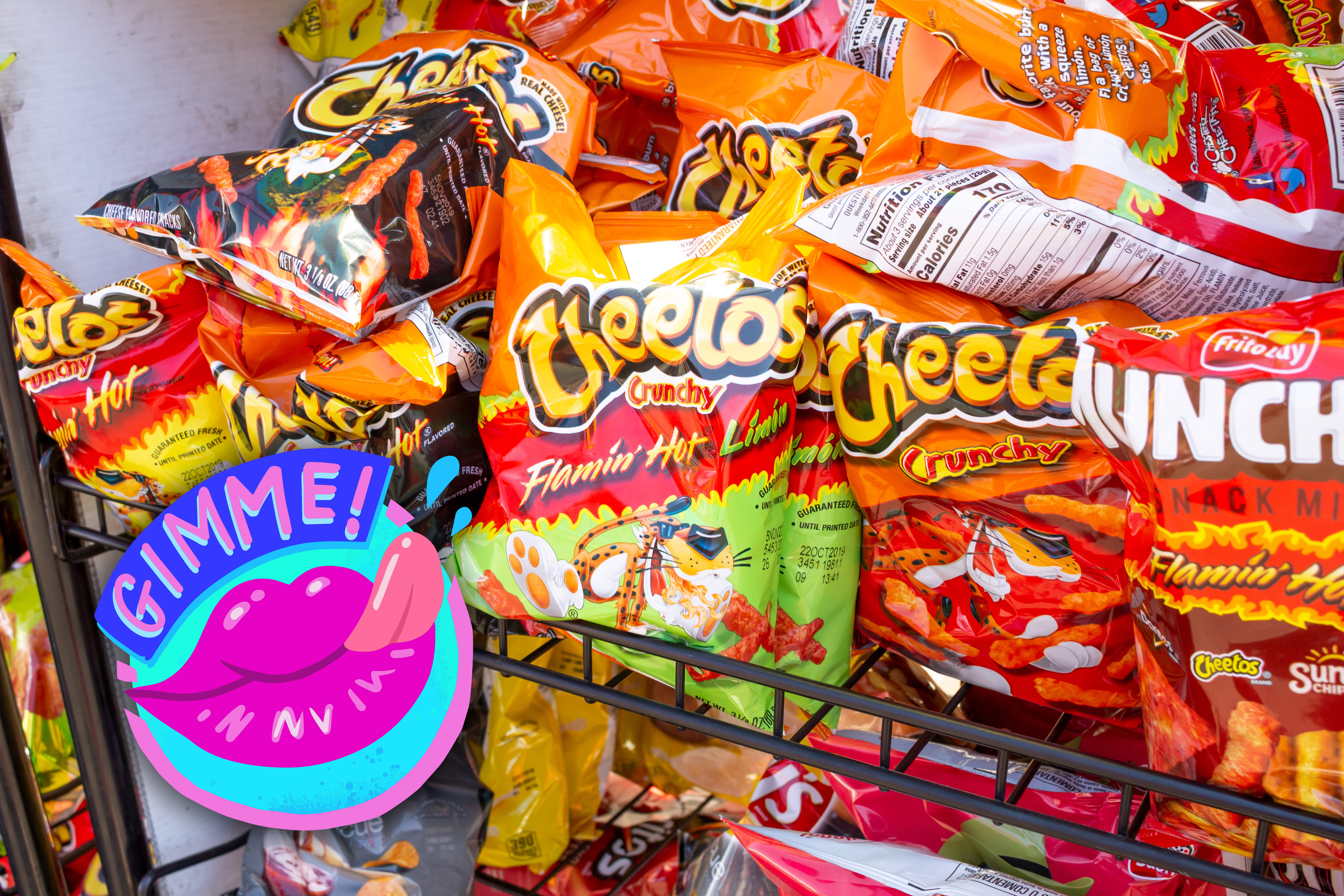 A rack in a store containing snack-sized bags of Cheetos, Flamin' Hot Cheetos, and Munchies.