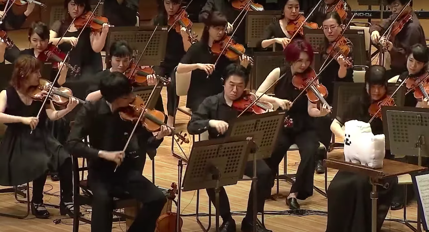 An orchestra plays music from Undertale.