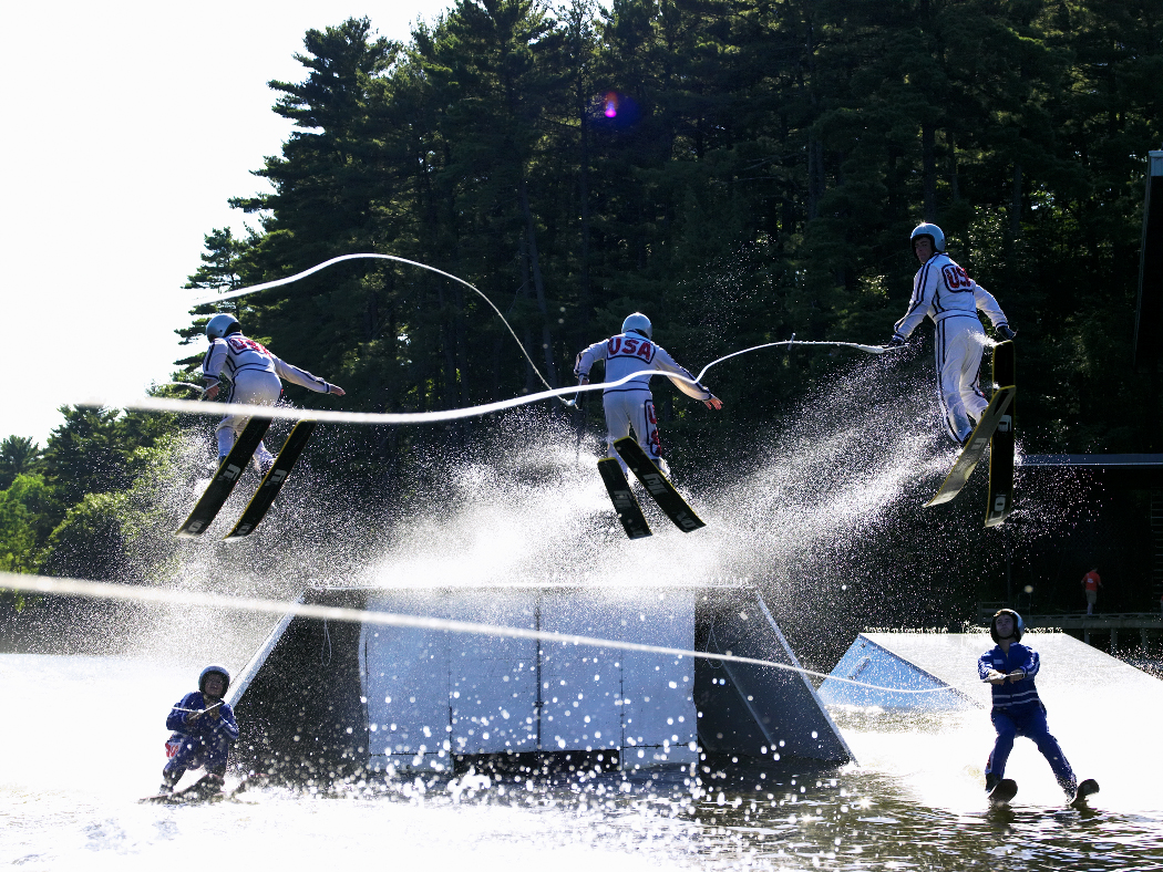 Members of the Tommy Bartlett Water Show perform the triple helicopter maneuver at Lake Delton, Wisconsin.