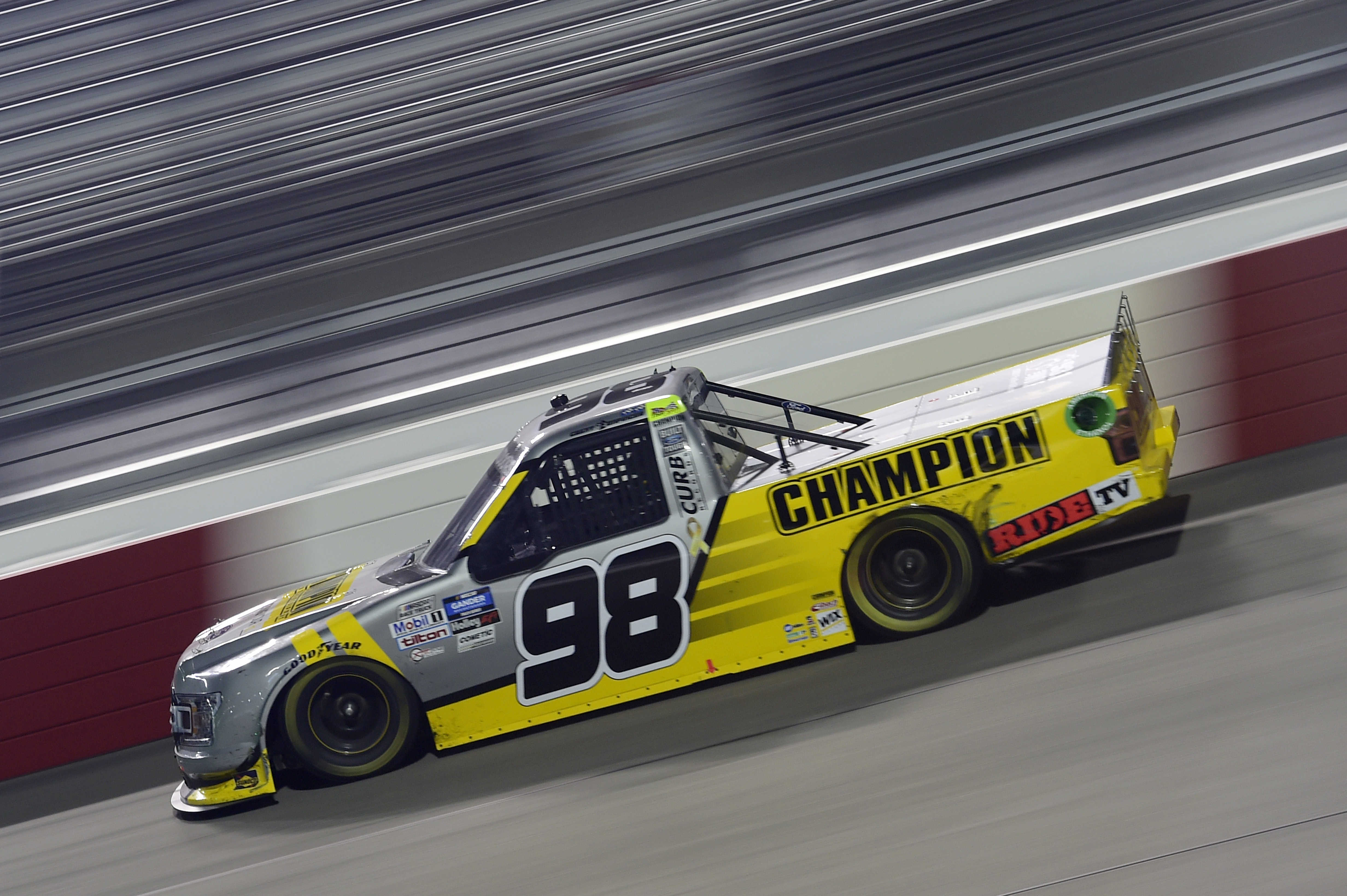 Grant Enfinger, driver of the #98 Champion/Curb Records Ford, drives during the NASCAR Gander Outdoors Truck Series ToyotaCare 250 at Richmond Raceway on September 10, 2020 in Richmond, Virginia.