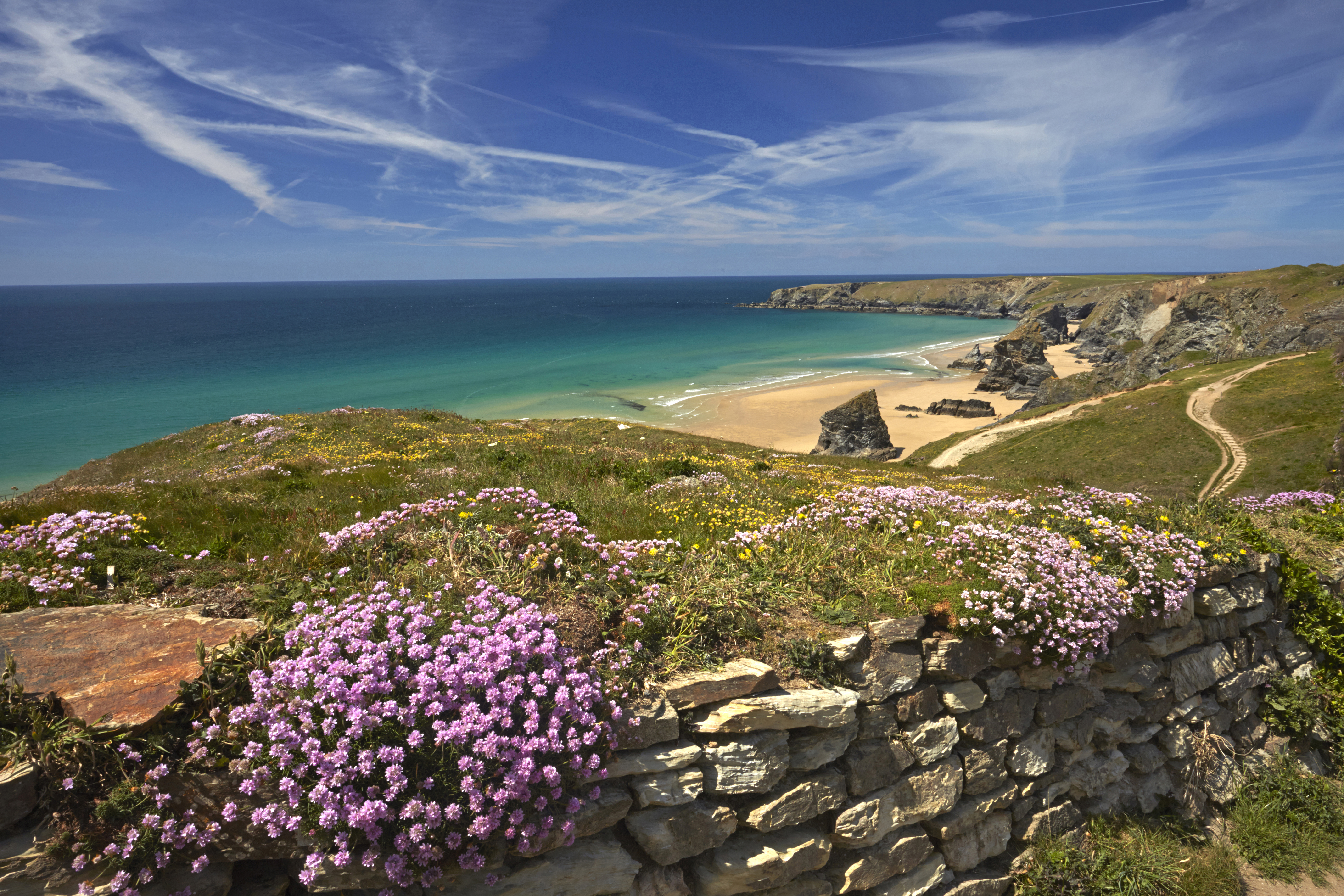 Bedruthan Steps, a jagged array of huge rocks on the sand on the Cornwall coast