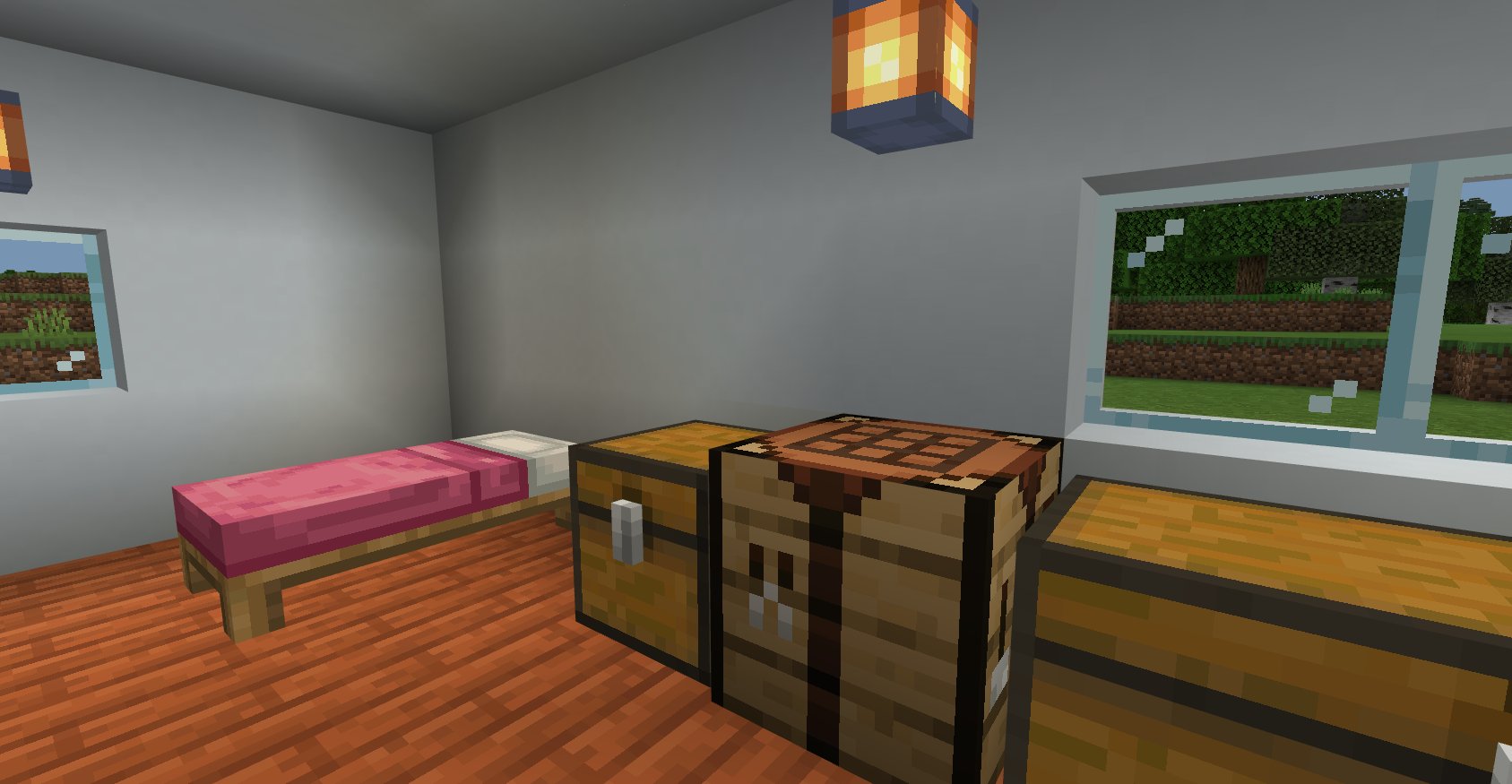 The inside of a Minecraft house, showing some Chests, a Crafting Table, and a Bed