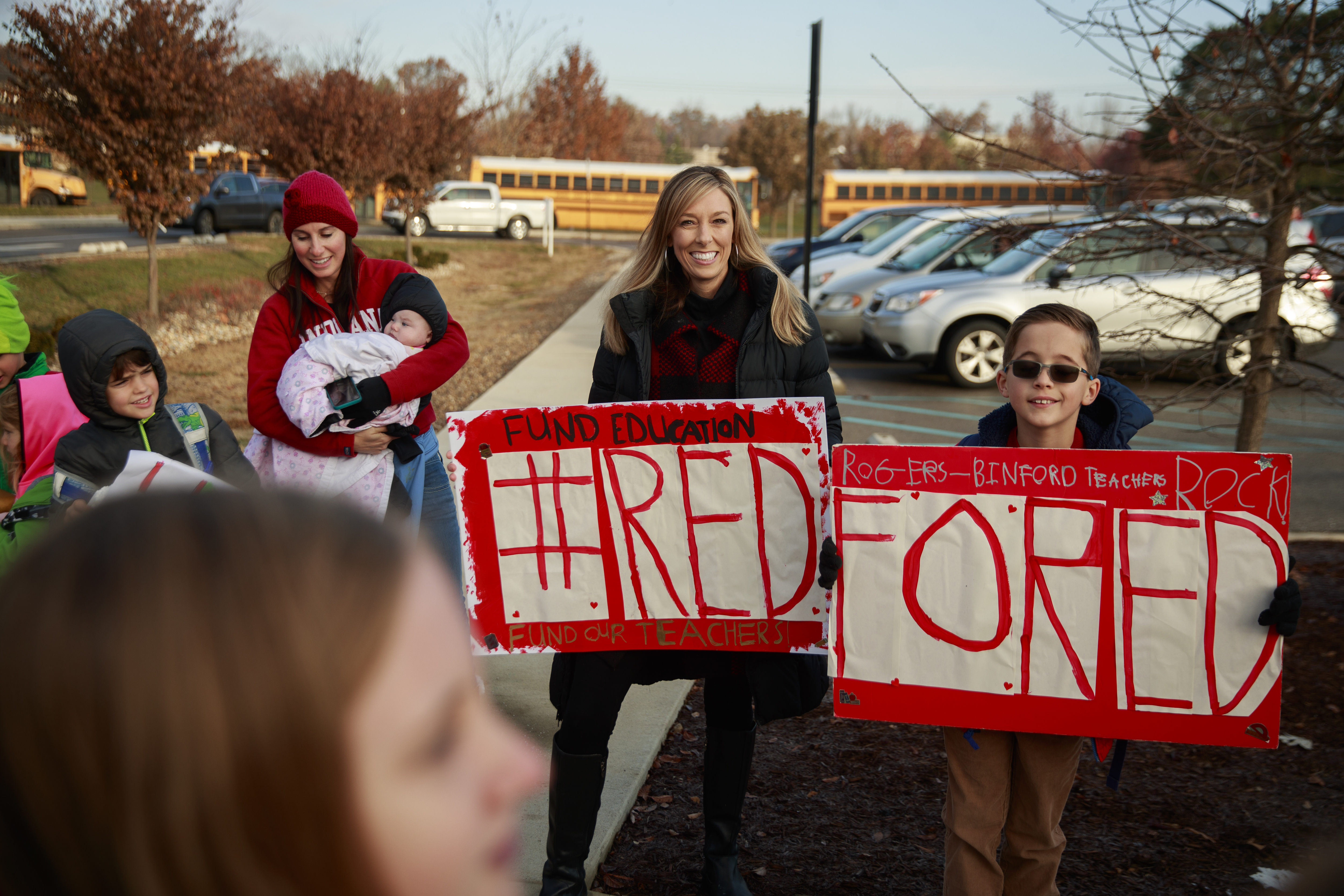 Teacher supporters demonstrate with signs during a Red for Ed protest.