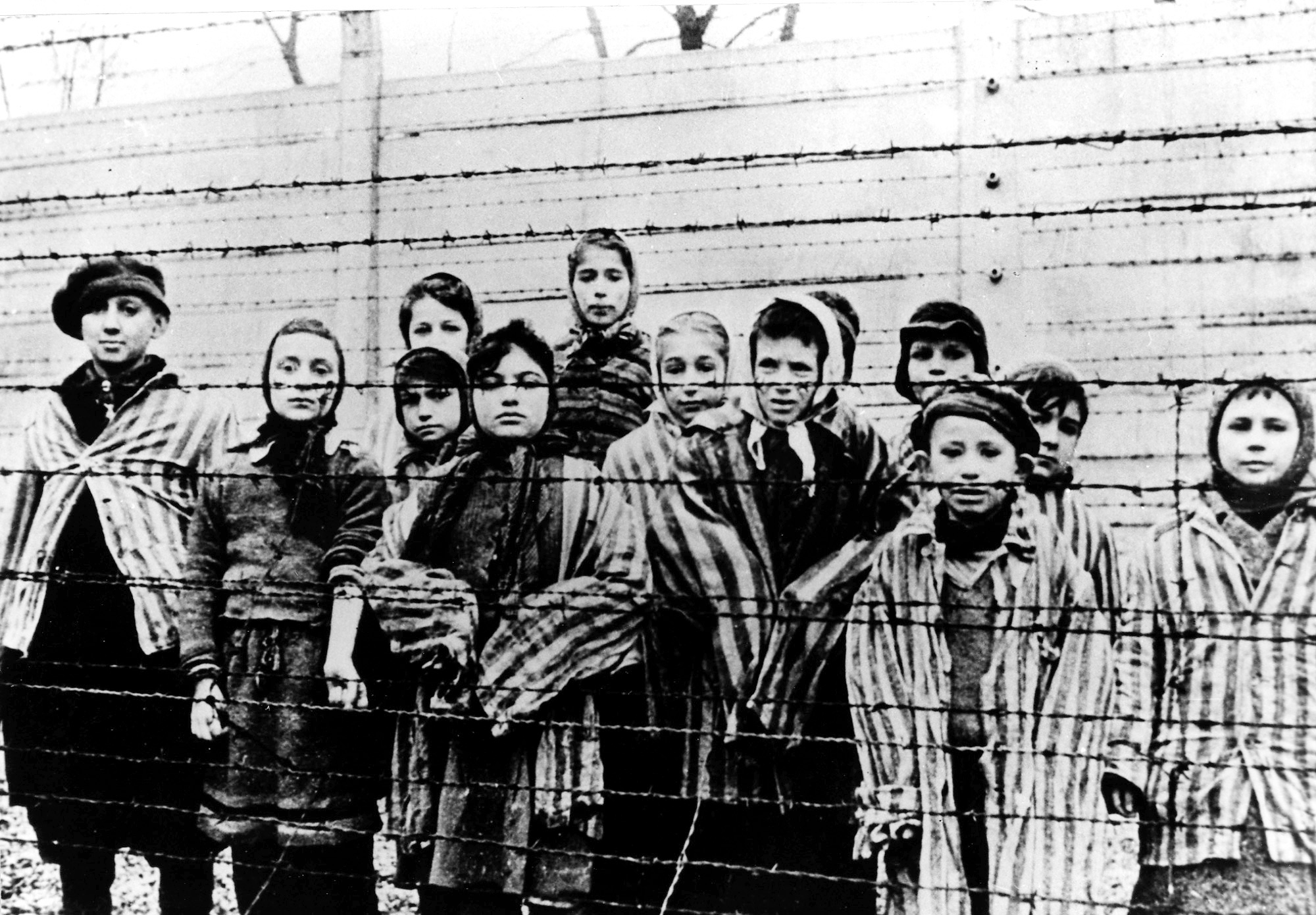 A picture taken just after the liberation by the Soviet army in January, 1945, shows a group of children wearing concentration camp uniforms, at the time behind barbed wire fencing in the Oswiecim (Auschwitz) Nazi concentration camp.