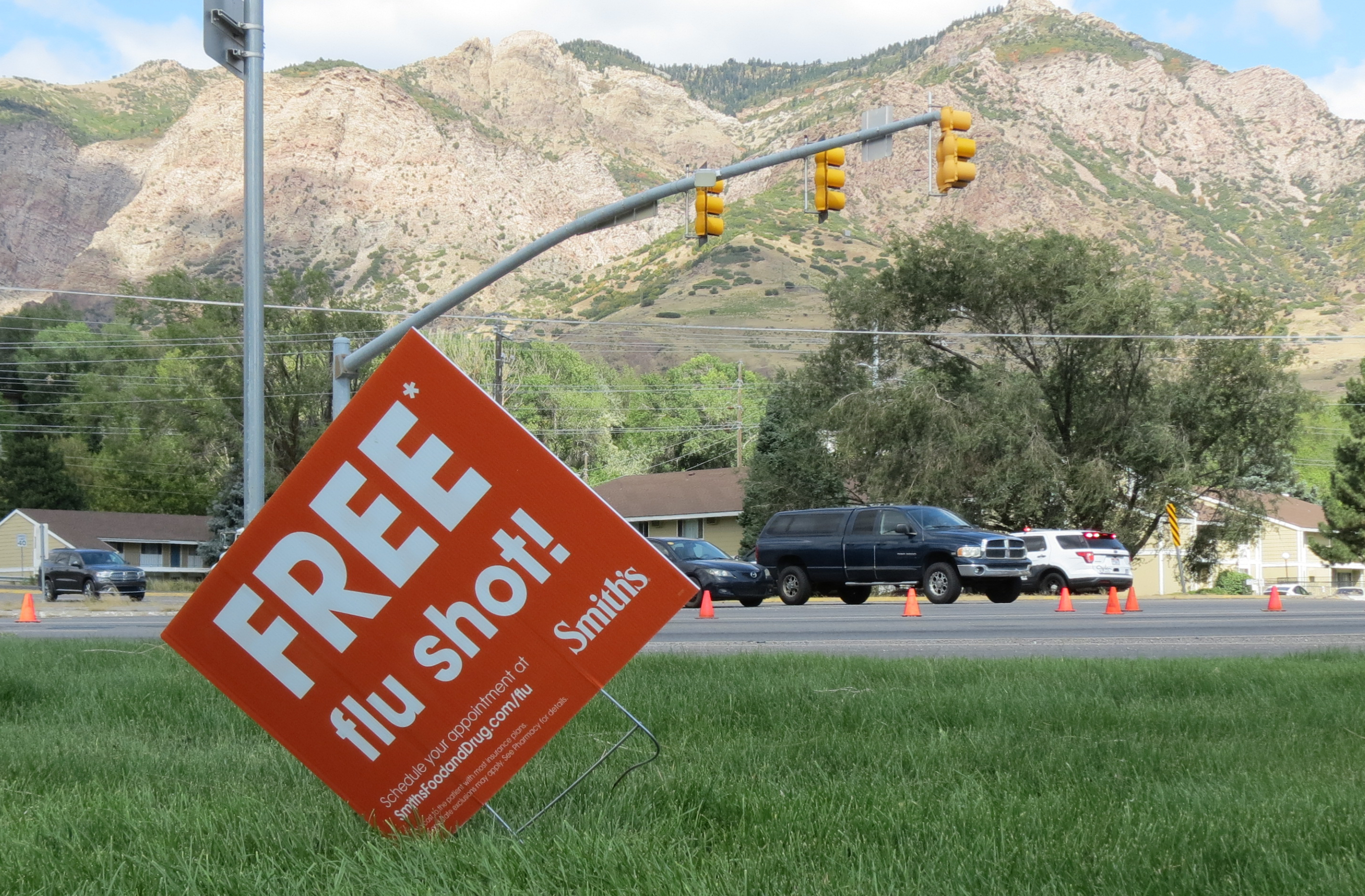 A sign advertising flu shots is displayed on Tuesday, Sept. 8, 2020, in Ogden, Utah. The annual flu season is gearing up alongside the coronavirus pandemic, and Utah health officials are encouraging people to get their flu shots.