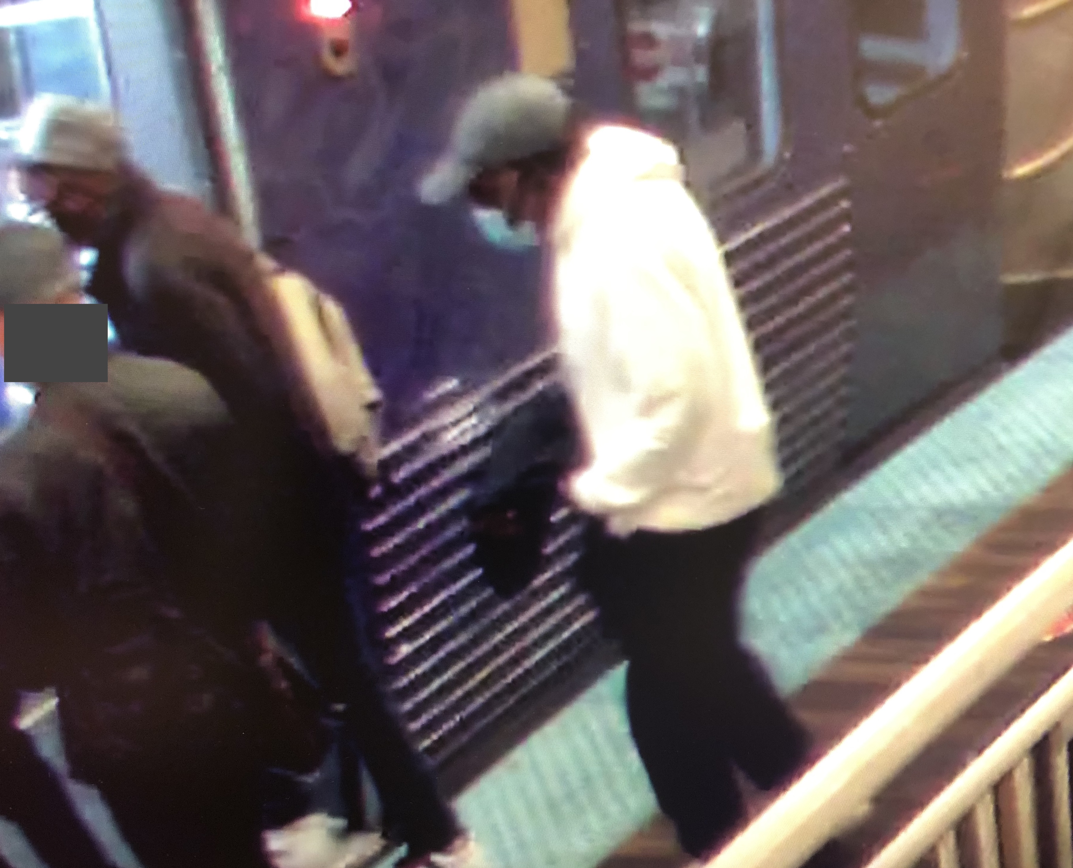 Chicago police say a CTA video shows a pickpocketing team stealing a man's wallet on Sept. 8 on the Washington Street L stop in the Loop. Police identified the man in the white sweatshirt as Edward Miller, who is charged with felony theft in a series of pickpocketing cases. The man with his head blurred is the victim.