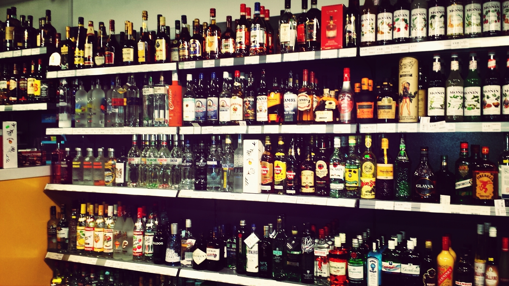 Bottles of liquor on store shelves.