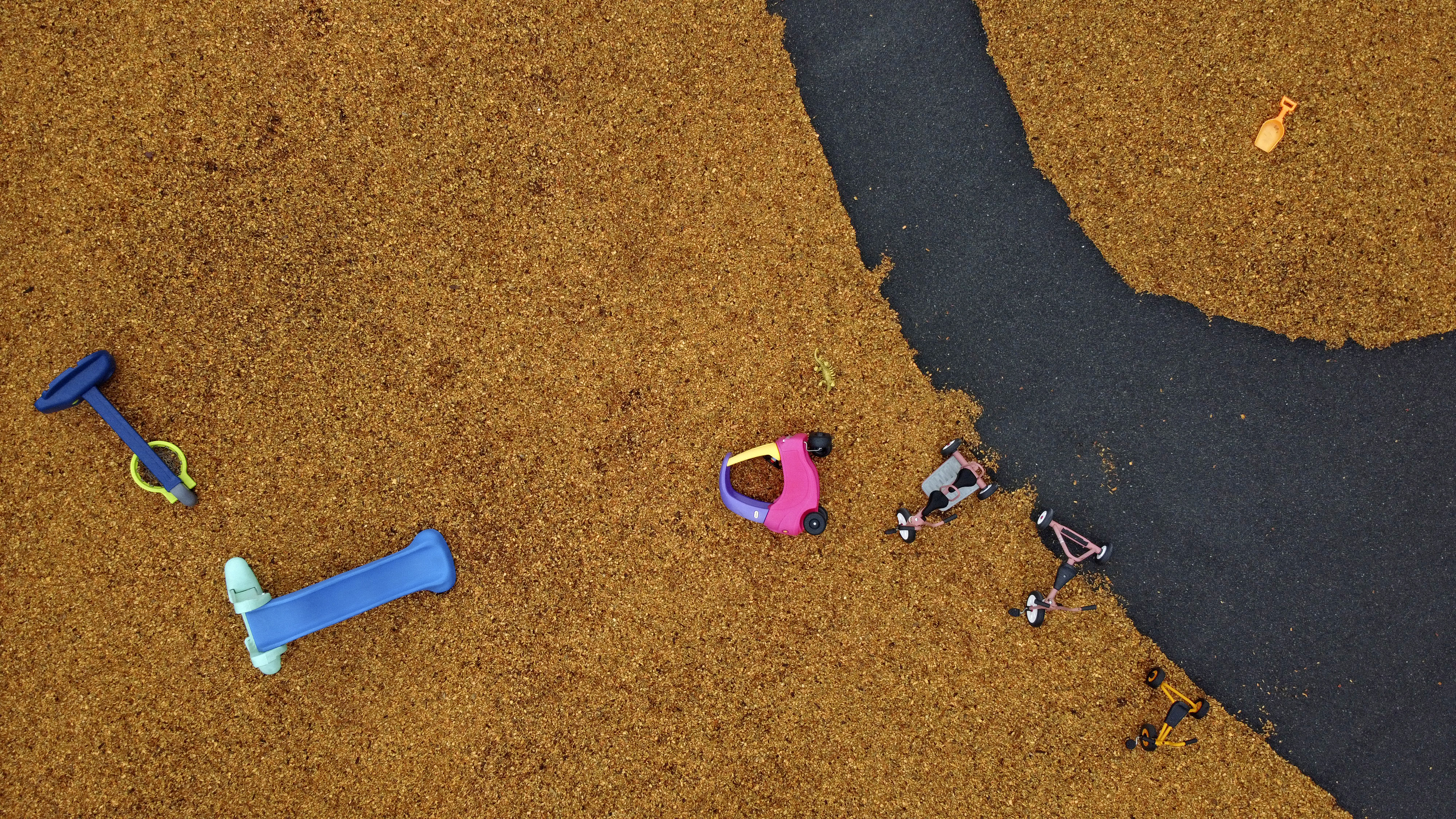 Toys lie scattered on an empty playground outside a school closed to stop the spread of coronavirus, Monday, March 30, 2020, in Attleboro, Mass. It's a scene playing out all over the world.