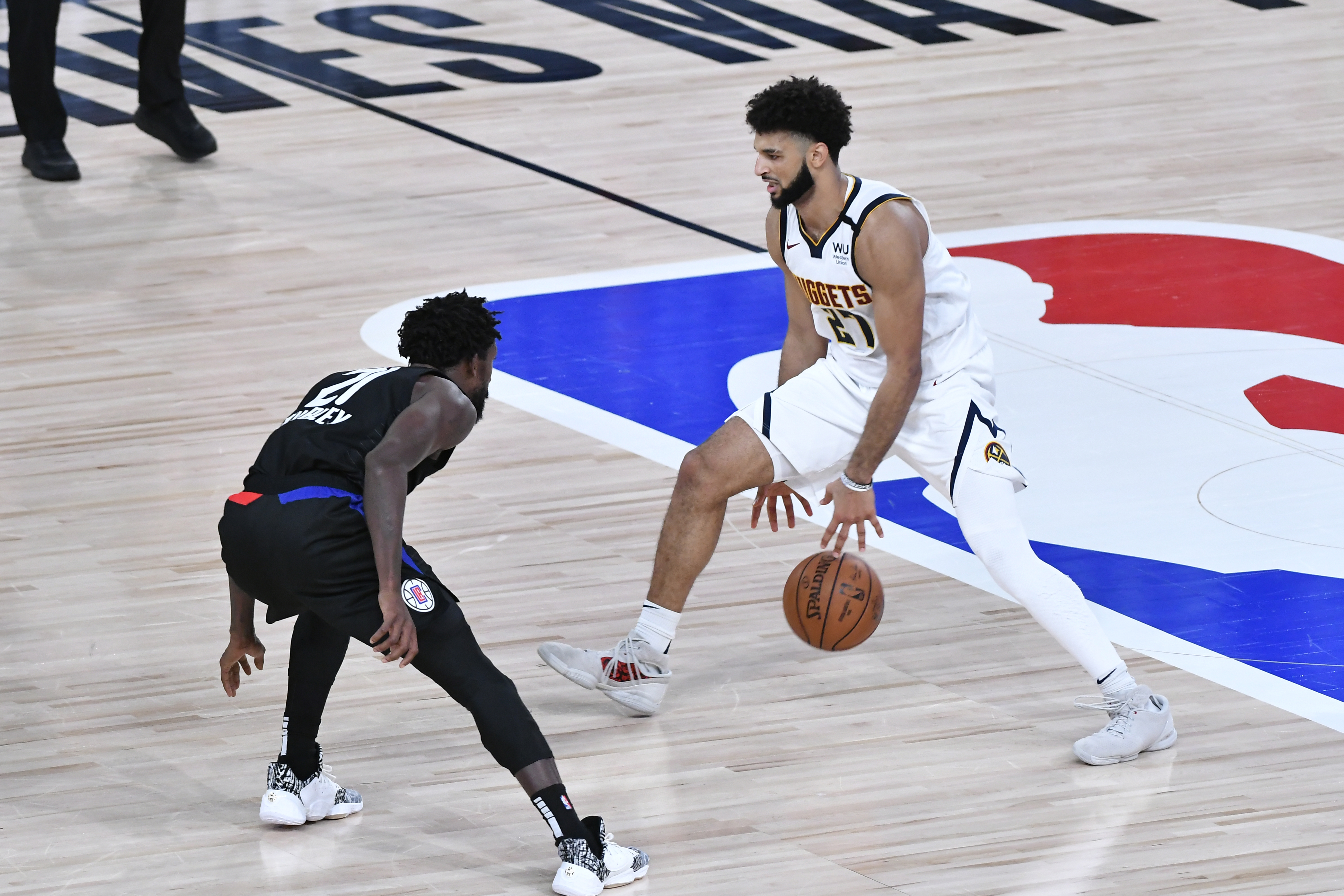 Jamal Murray of the Denver Nuggets handles the ball against the LA Clippers during Game Seven of the Western Conference SemiFinals of the NBA Playoffs on September 15, 2020 at AdventHealth Arena in Orlando, Florida.