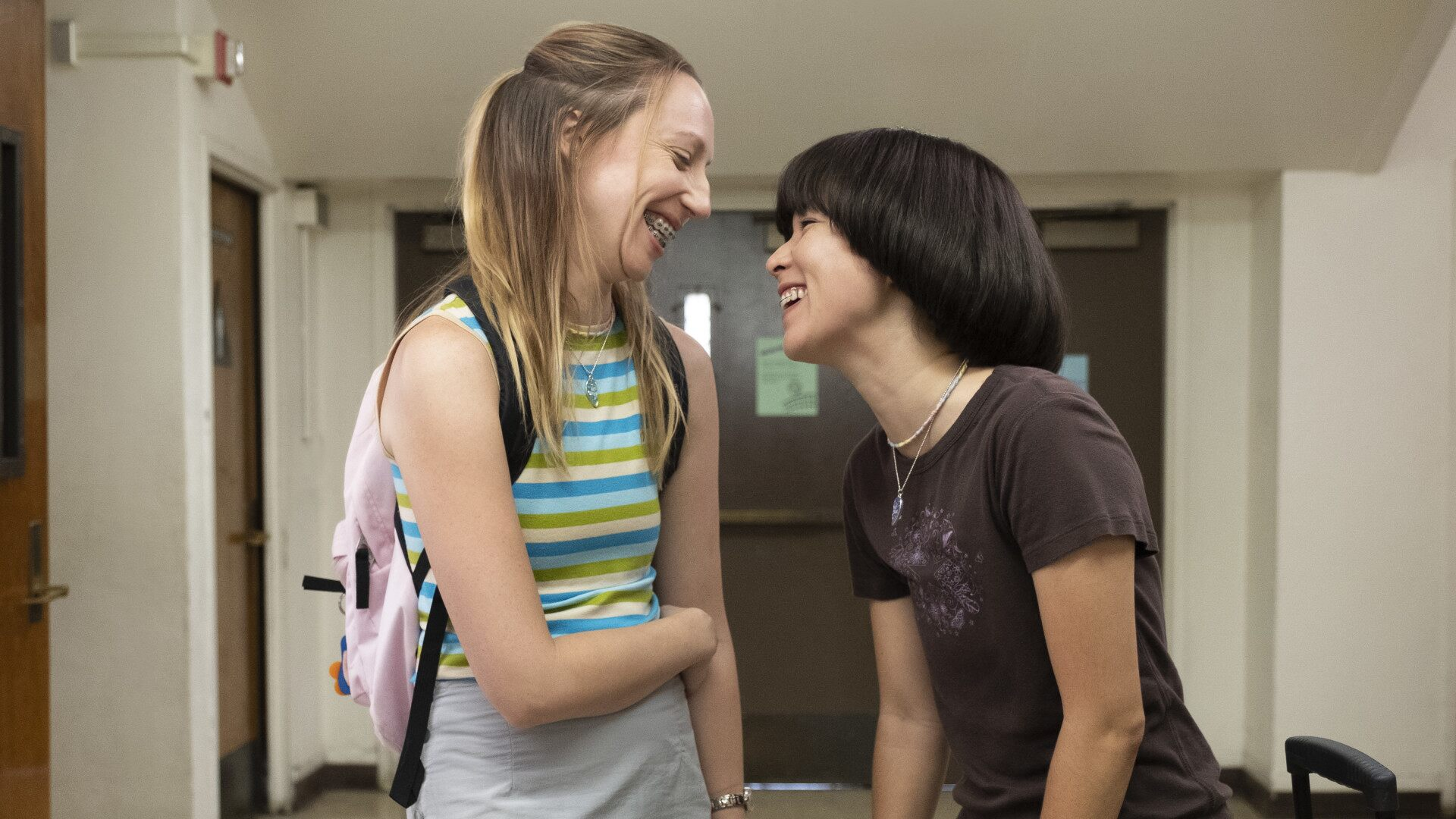 Anna (left) and Maya smiling at each other in a scene on PEN15