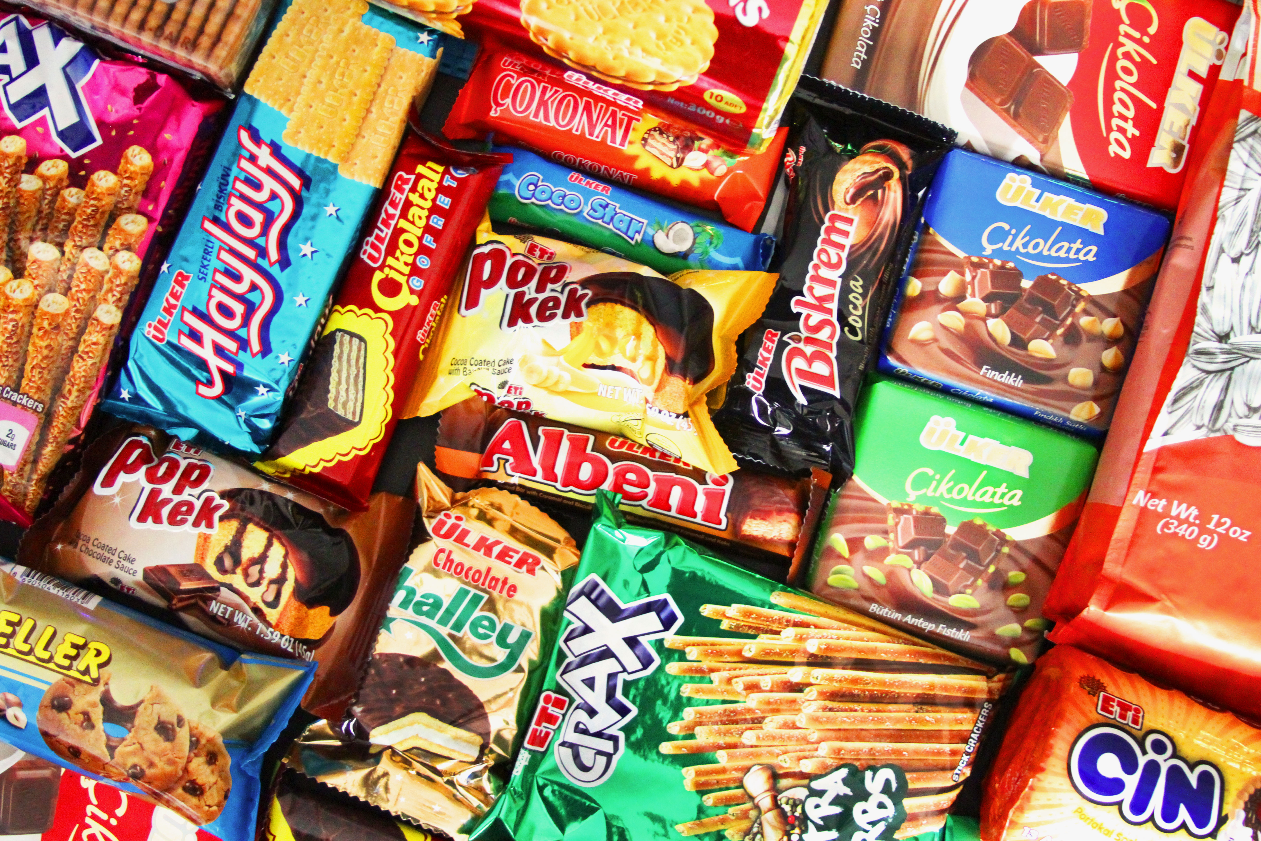 An array of Turkish snacks in bright-colored packaging.