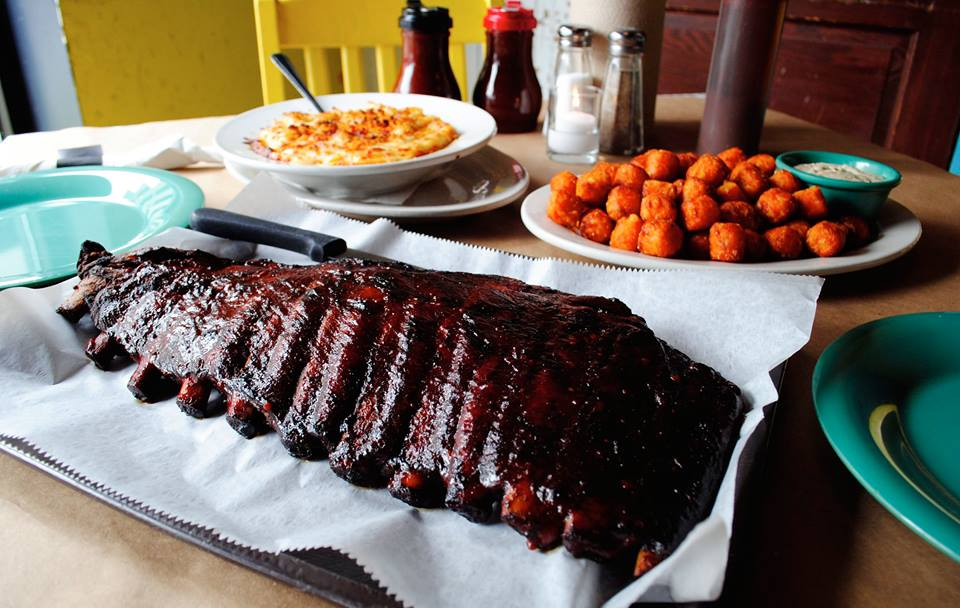 A plate of barbecue ribs with sides.