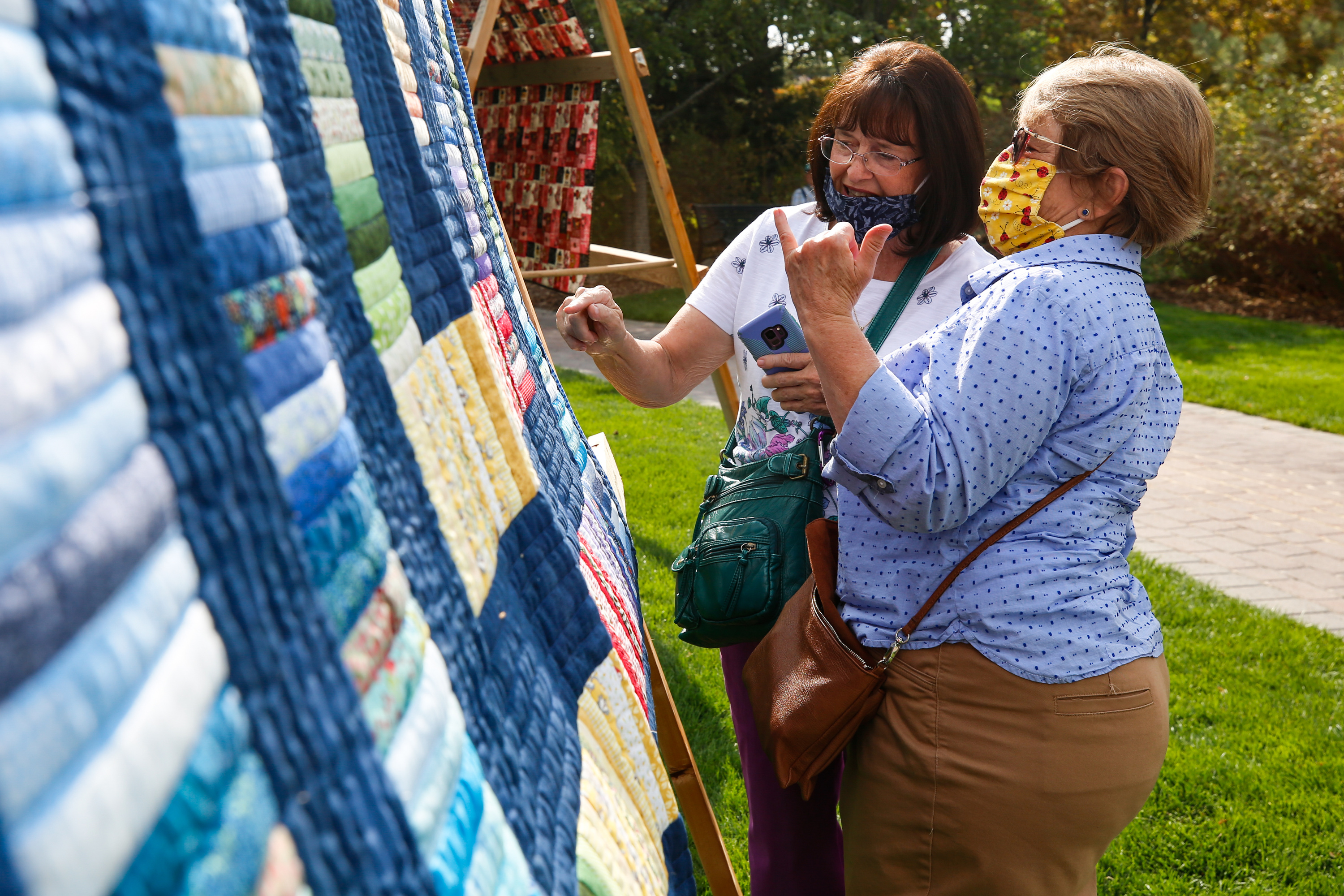 Marilyn Robson, left, and Christine Caldwell talks about quilt during the Garden of Quilts show at Ashton Gardens at Thanksgiving Point in Lehi on Friday, Sept. 18, 2020.
