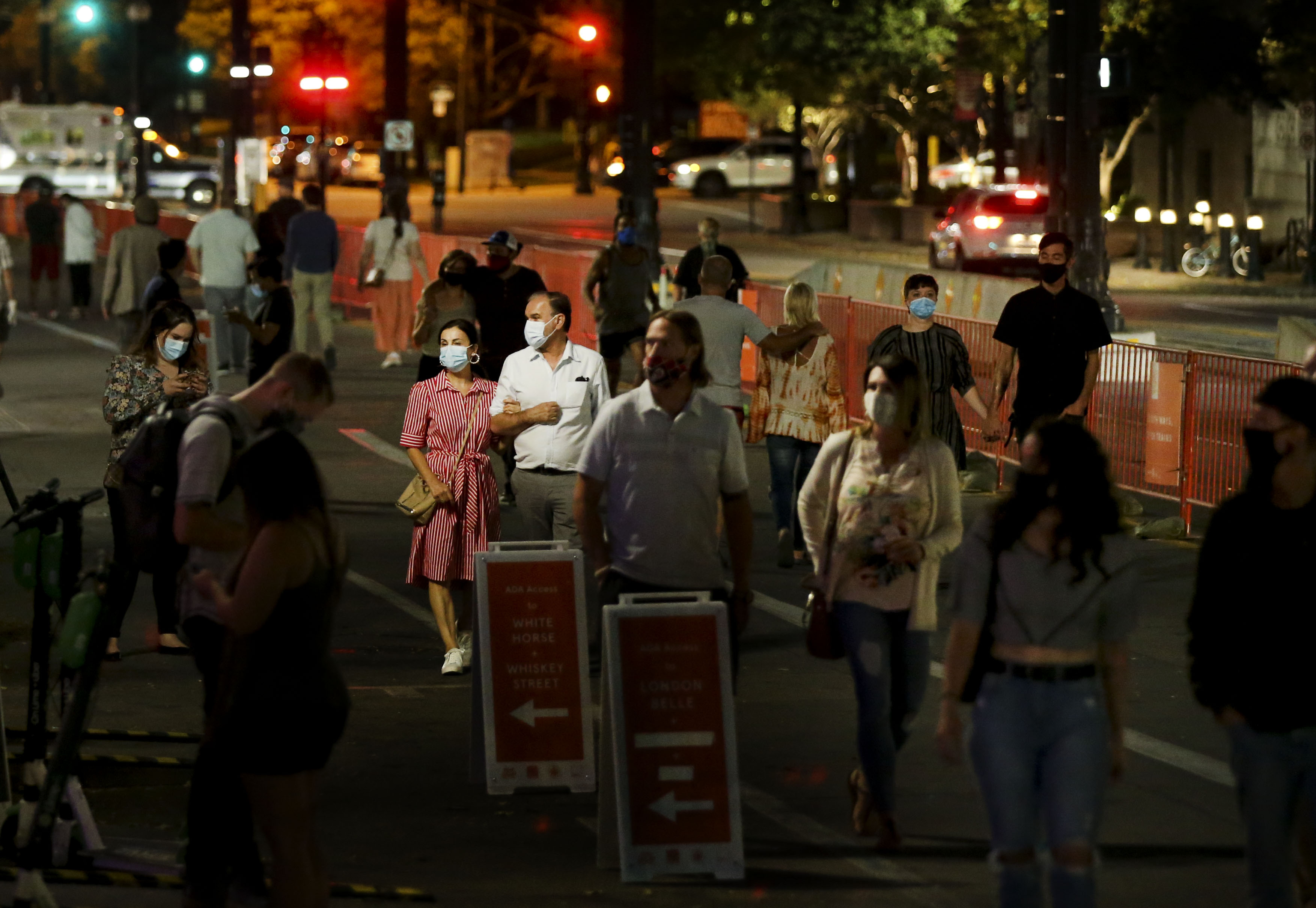 People stroll up Main Street during Downtown SLC Open Streets in Salt Lake City on Friday, Sept. 18, 2020. As part of the program, northbound traffic will be shut down from 300 South to 400 South on Main Street every Thursday, Friday and Saturday evening through Oct. 10 and restaurants will expand their presence on the sidewalks.