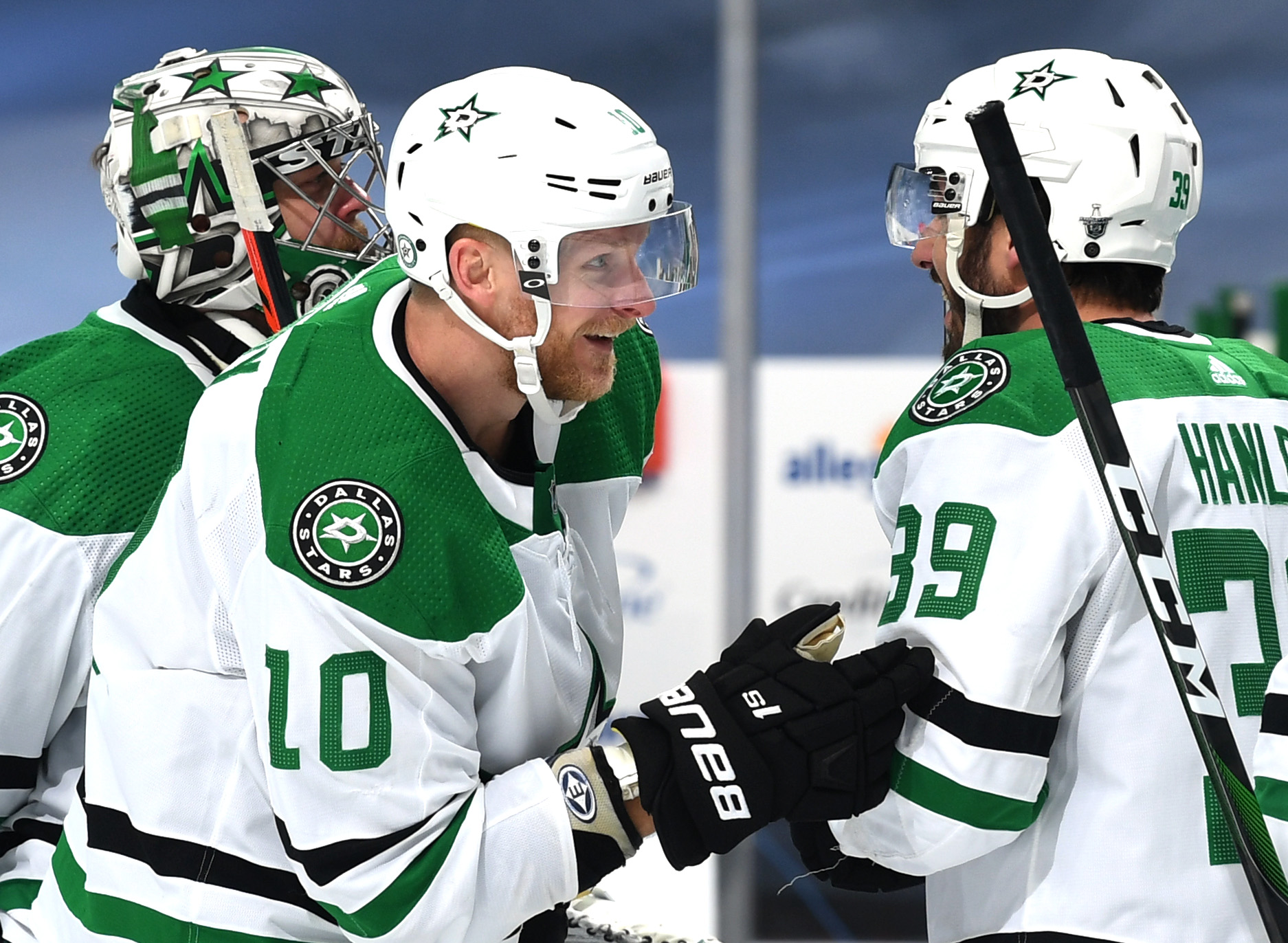 EDMONTON, ALBERTA - SEPTEMBER 14: Corey Perry #10 and Joel Hanley #39 of the Dallas Stars celebrate after the Stars 3-2 overtime win against the Vegas Golden Knights in Game Five of the Western Conference Final of the 2020 NHL Stanley Cup Playoffs between the Dallas Stars and the Vegas Golden Knights at Rogers Place on September 14, 2020 in Edmonton, Alberta.