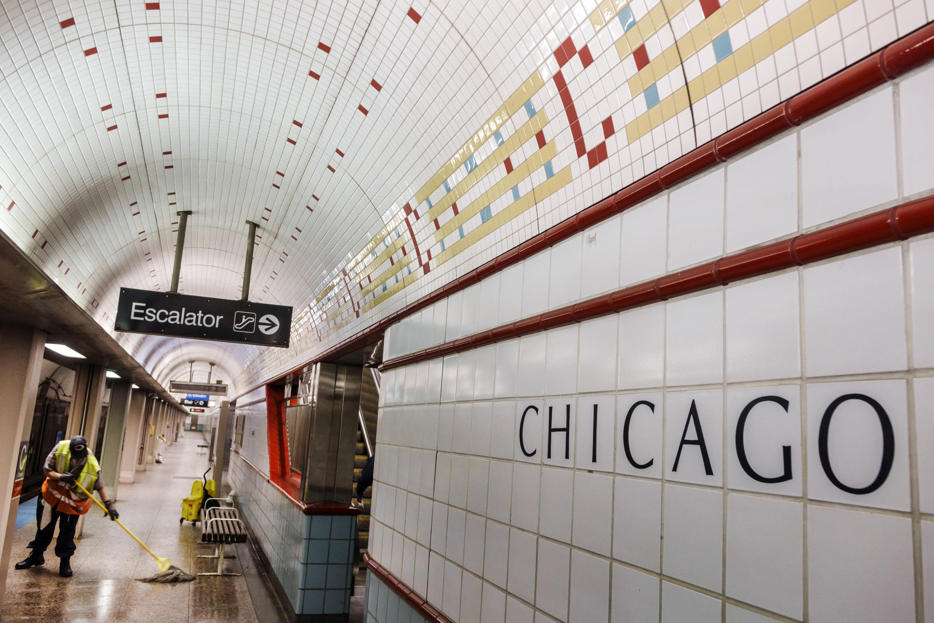 Chicago station escalator sign.