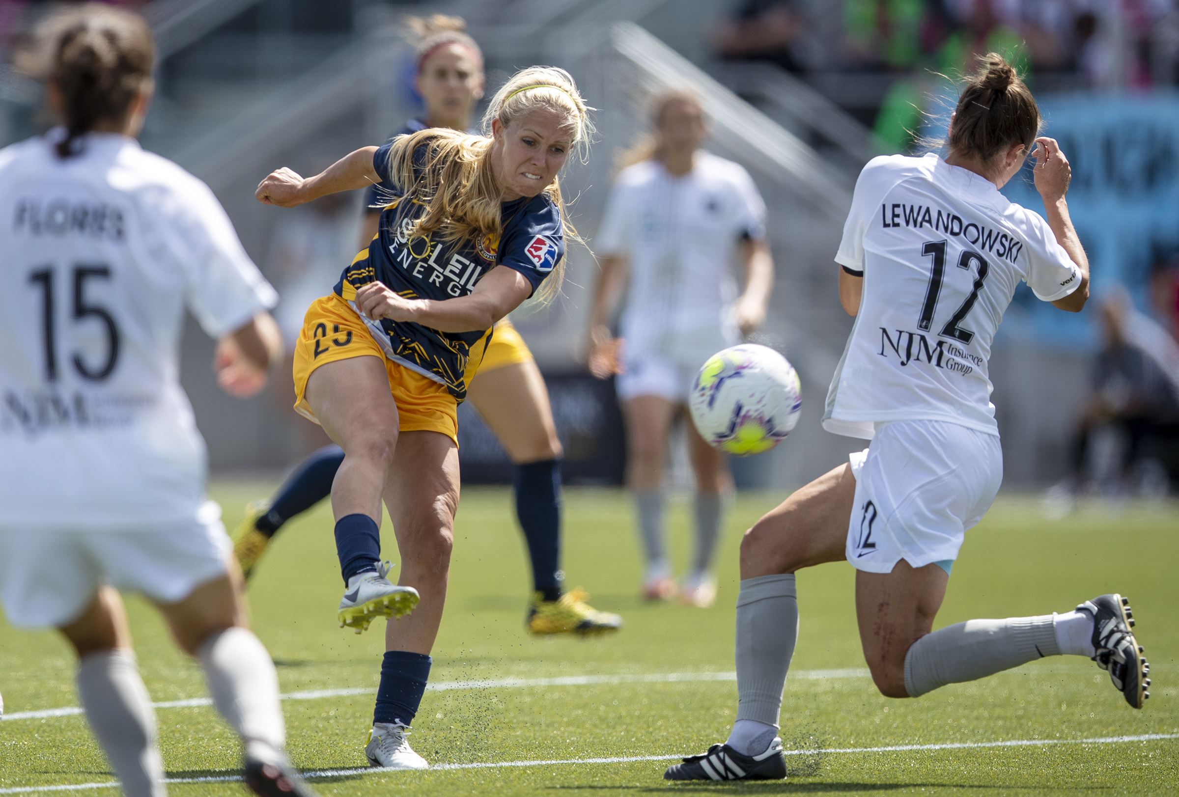 Utah Royals FC forward Brittany Ratcliffe (25) fires a shot into the leg of Sky Blue FC defender Gina Lewandowski (12) as the Utah Royals and Sky Blue play in the National Women's Soccer League Challenge Cup at Zions Bank stadium in Herriman on Saturday, July 4, 2020. Utah won 1-0.
