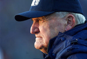 BYU coach LaVell Edwards watches his team as the sun sets in his eyes during his final game at Cougar (now LaVell Edwards Stadium) Saturday, Nov. 18, 2000.