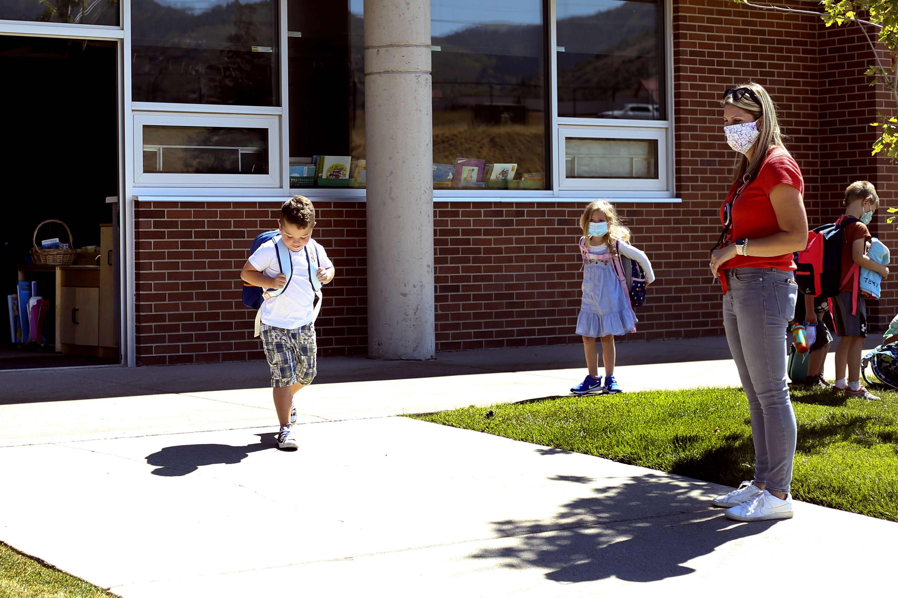 Dominic Francese, left, exits his classroom after school at Jeremy Ranch Elementary School in Park City on Friday, Sept. 4, 2020. Parents have been asked to remain in their cars during pickup and drop off at school. Francese's mother, Laura, would like the ability to get general COVID information about cases or outbreaks in schools. Currently there is no comprehensive information, although the state is working on a dashboard.