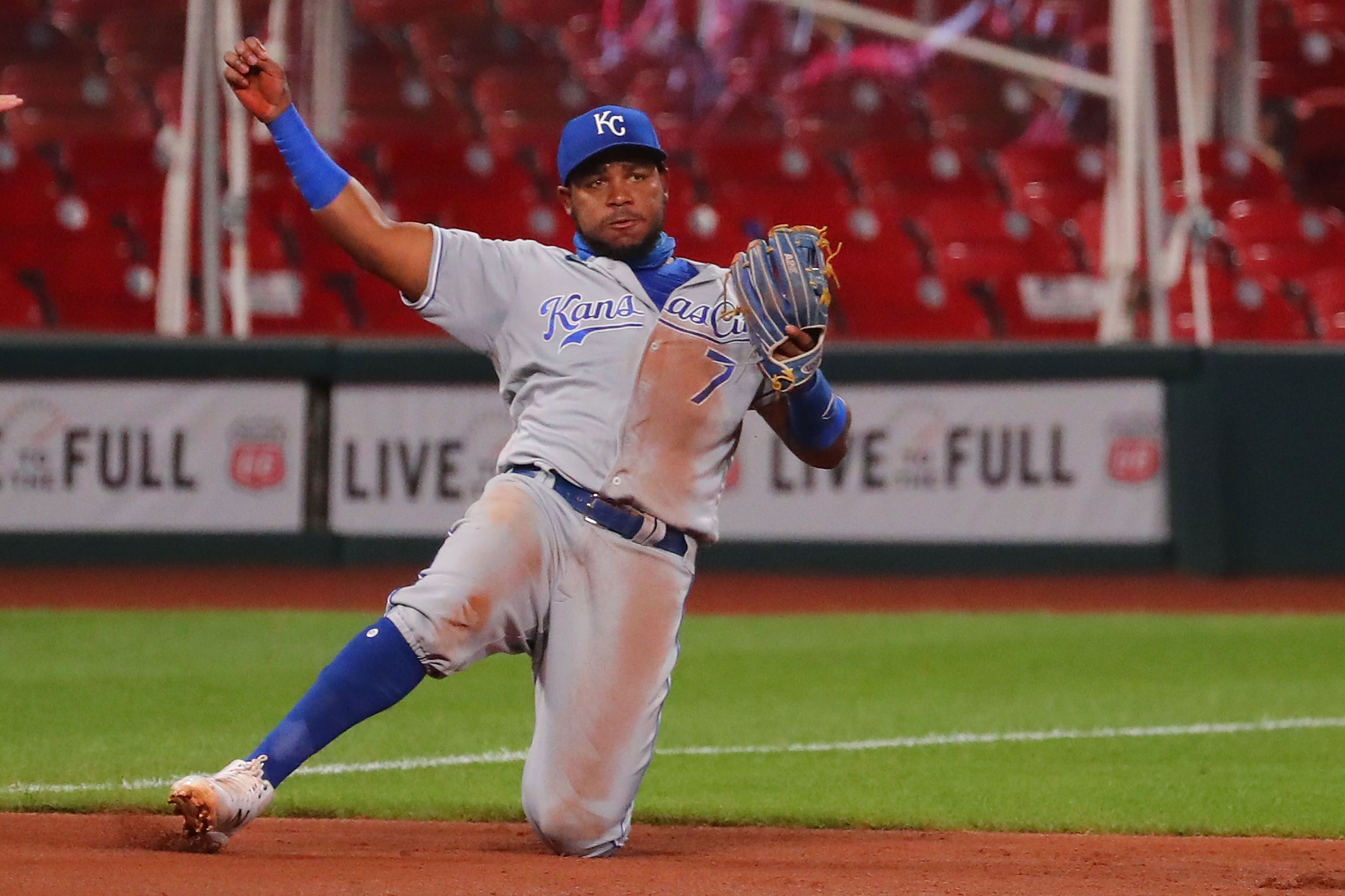 Maikel Franco #7 of the Kansas City Royals reacts after committing a throwing error against the St. Louis Cardinals in the third inning that led to a run scoring in the third inning at Busch Stadium on August 25, 2020 in St Louis, Missouri.