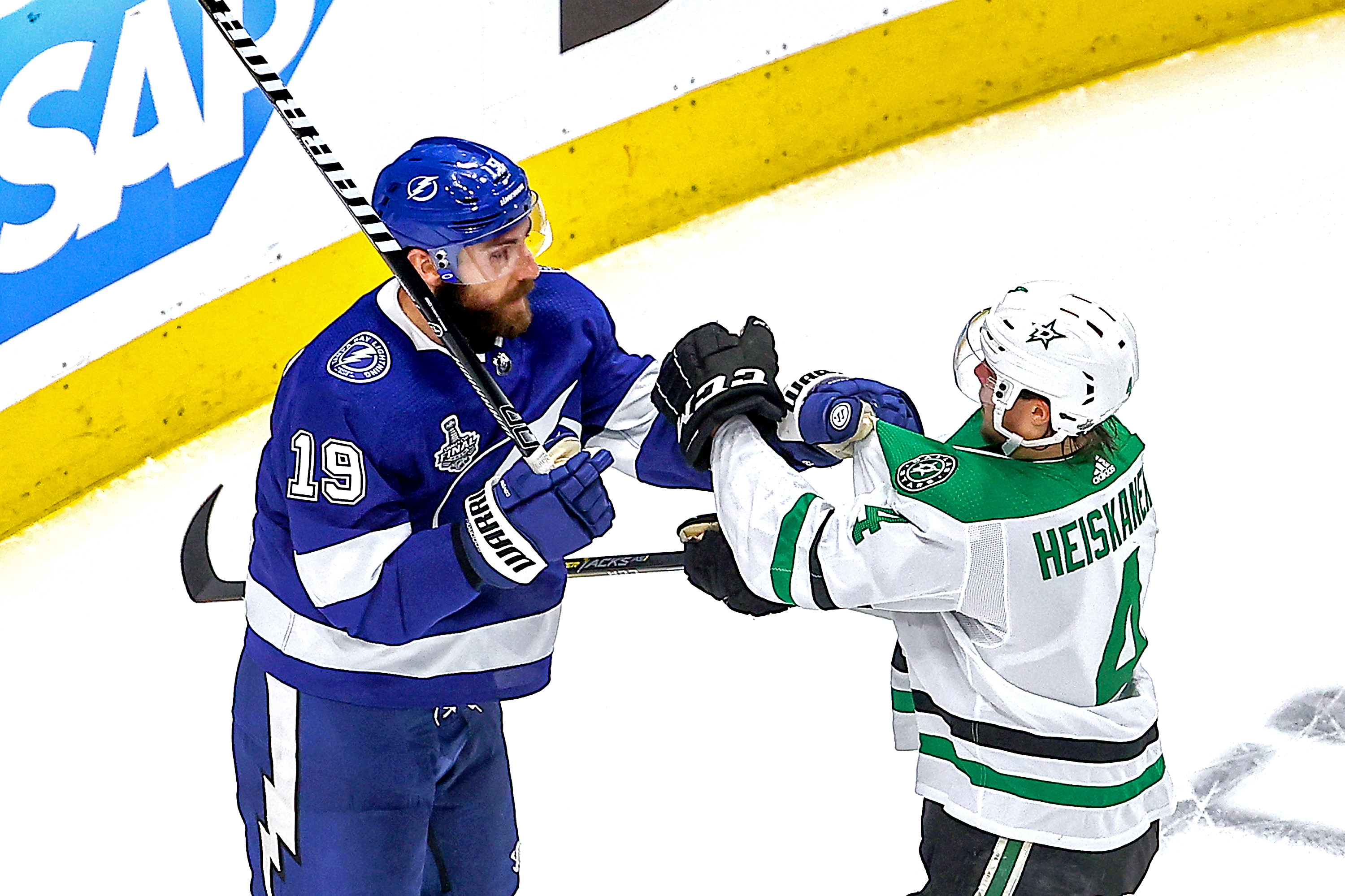 Barclay Goodrow #19 of the Tampa Bay Lightning and Miro Heiskanen #4 of the Dallas Stars scuffle during the third period in Game One of the 2020 NHL Stanley Cup Final at Rogers Place on September 19, 2020 in Edmonton, Alberta, Canada.