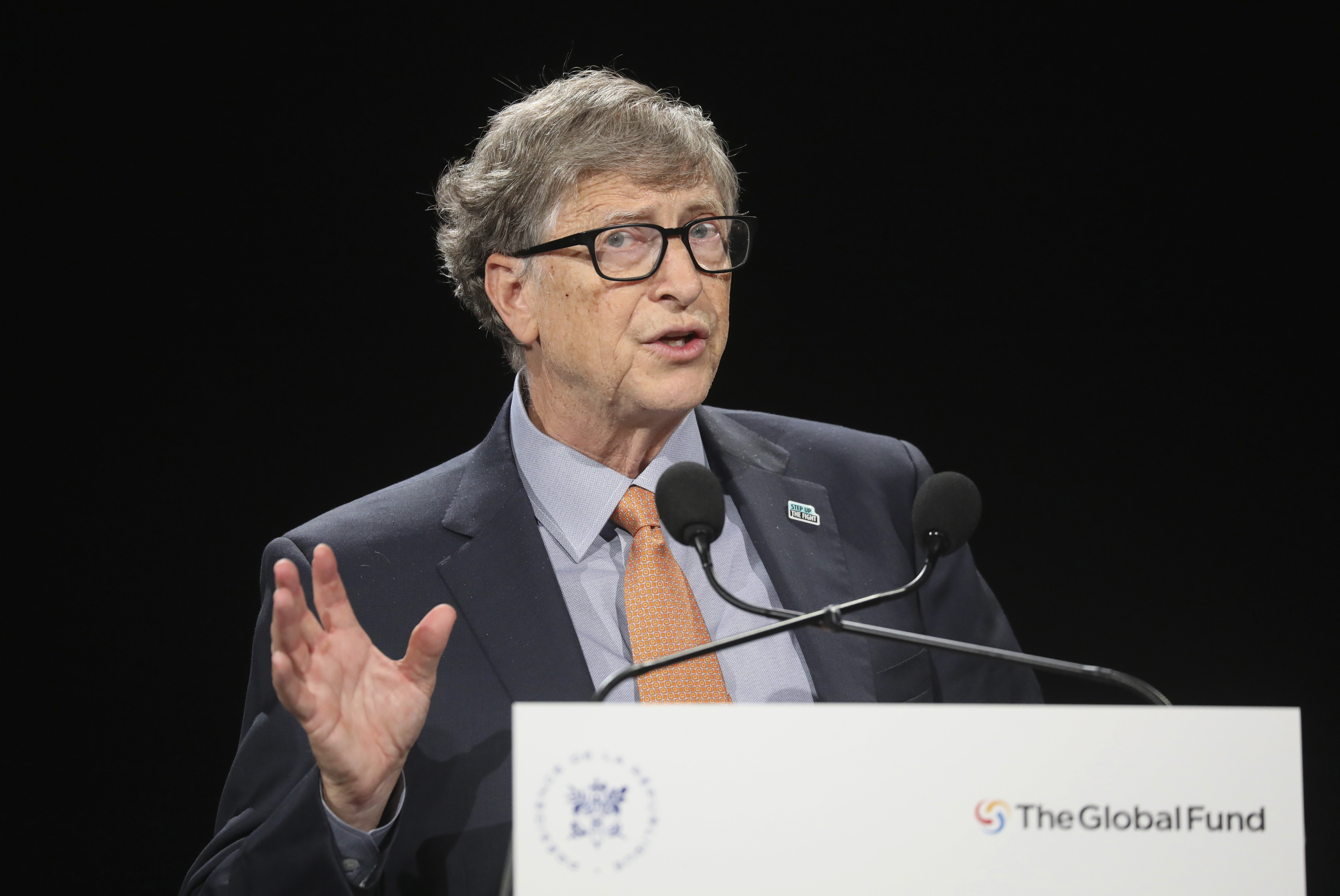 Philanthropist and Co-Chairman of the Bill & Melinda Gates Foundation Bill Gates gestures as he speaks to the audience during the Global Fund to Fight AIDS event at the Lyon's congress hall, central France.