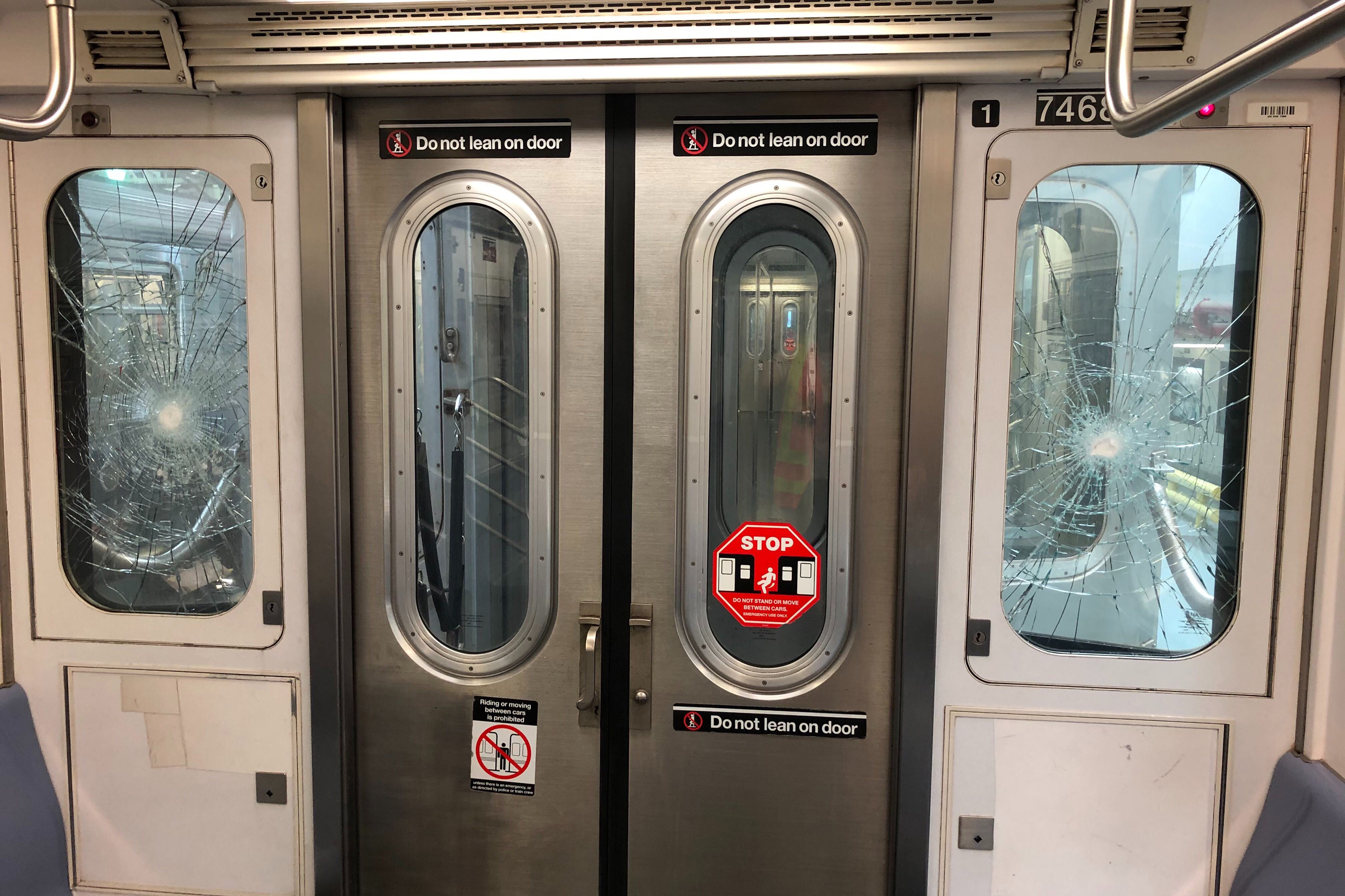 Smashed windows on a 7 train in Queens, Aug. 5, 2020.