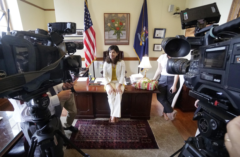 Maine House Speaker Sara Gideon talks with the media
