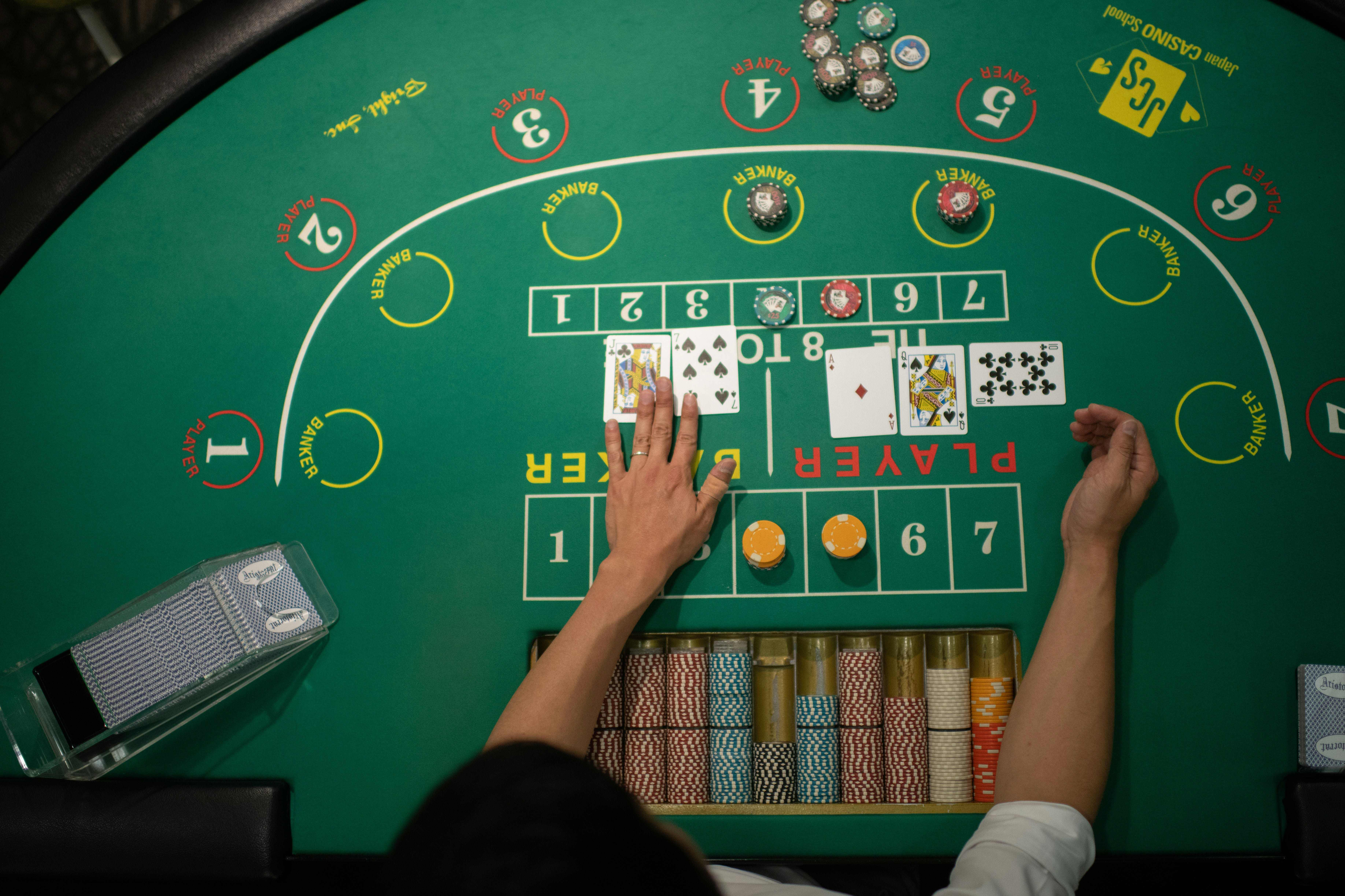 This picture taken on June 6, 2018 shows a student practicing baccarat at the Japan Casino School in Tokyo.