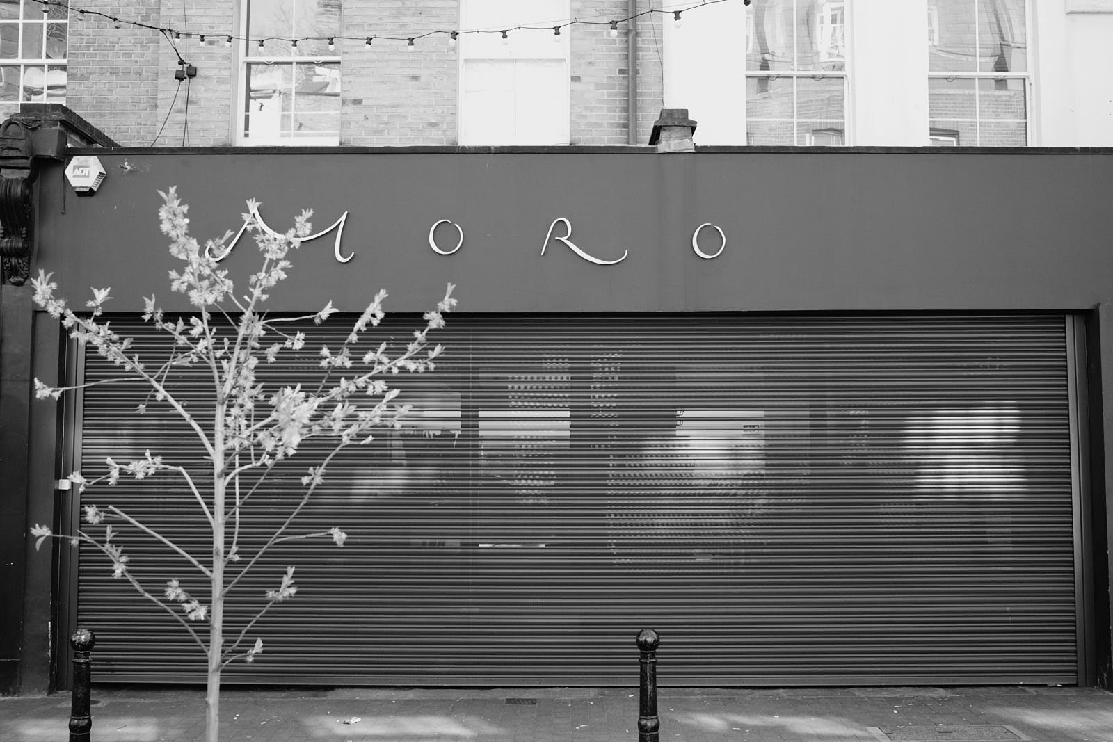 Moro, one of London's best restaurants, with its shutters down during COVID-19; the image is in black and white