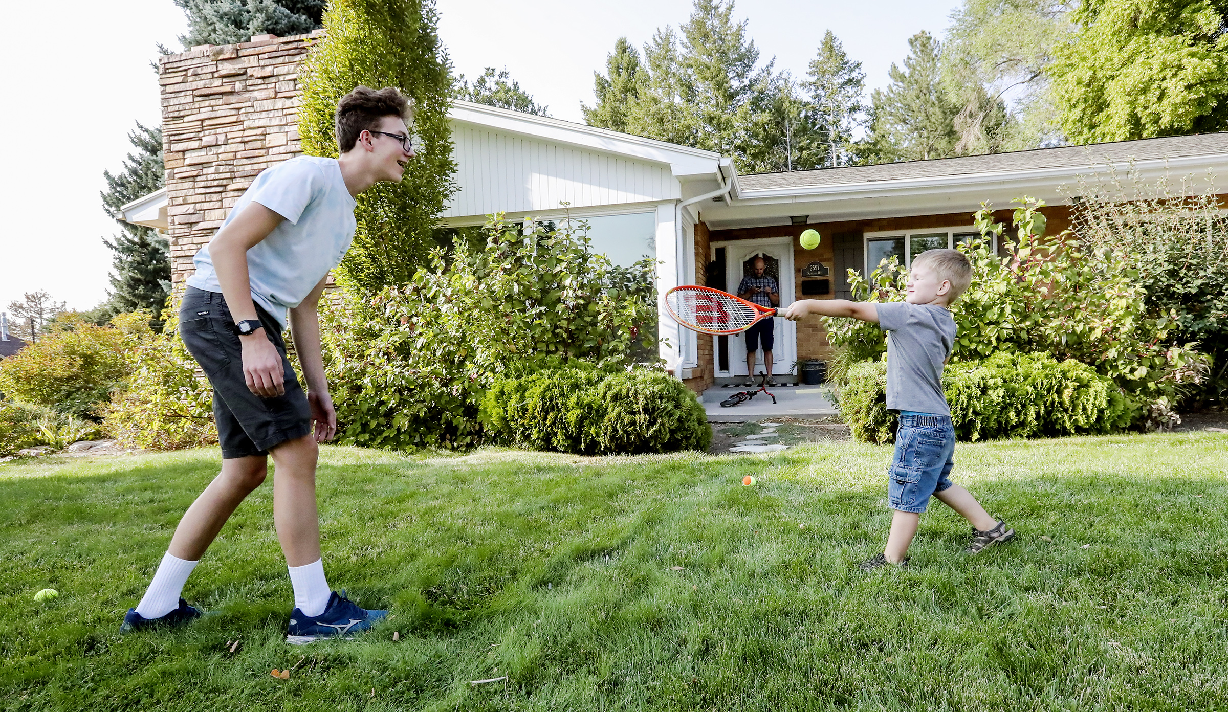 Peter Larsen plays with his brother George on the front lawn of their home in Salt Lake City on Wednesday, Sept. 16, 2020.