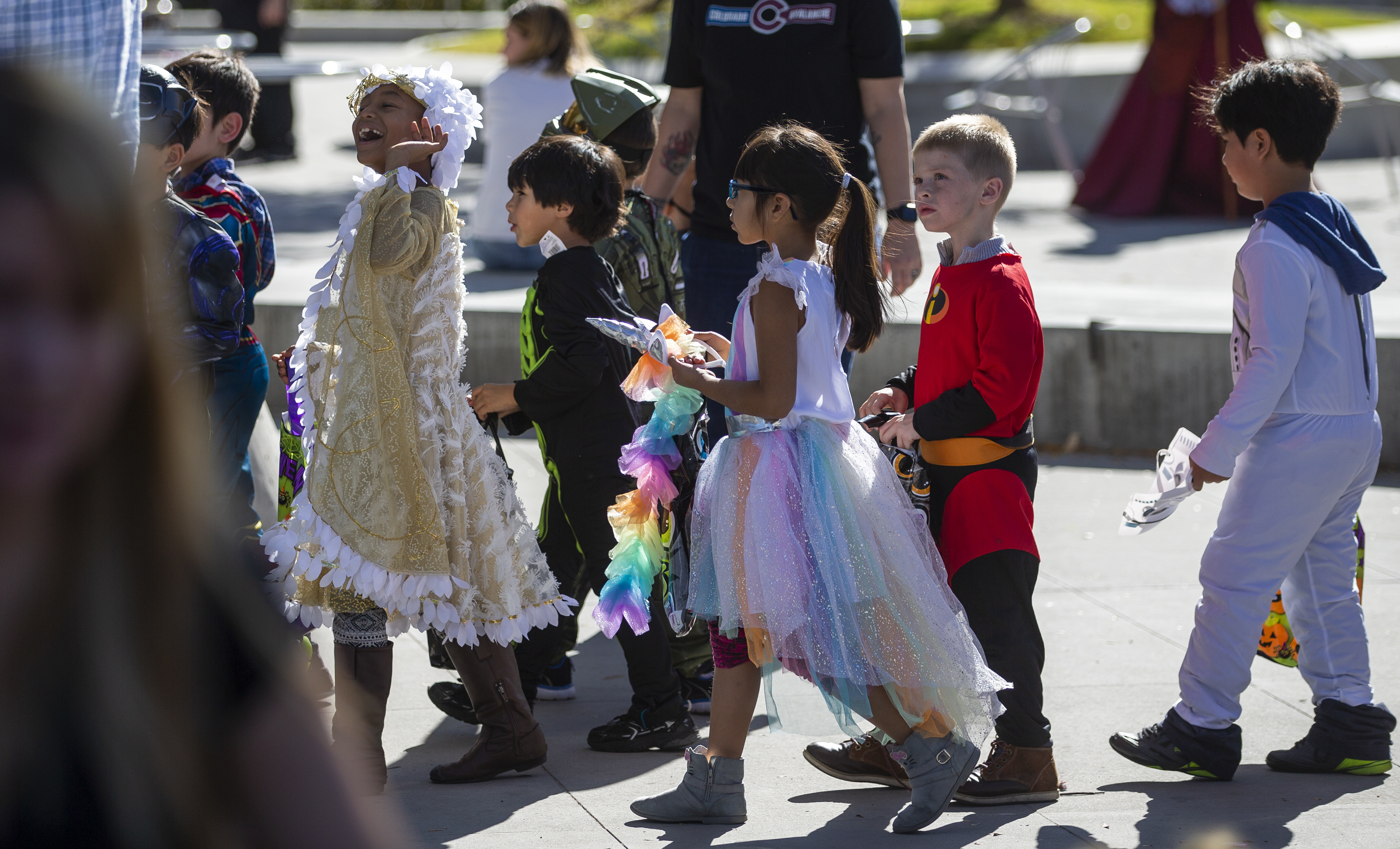 Kids dressed up in their halloween costumes enjoy the party as Salt Lake City Police and Fire Departments host a halloween party at the Public Safety building in Salt Lake City on Friday, Oct. 26, 2018.