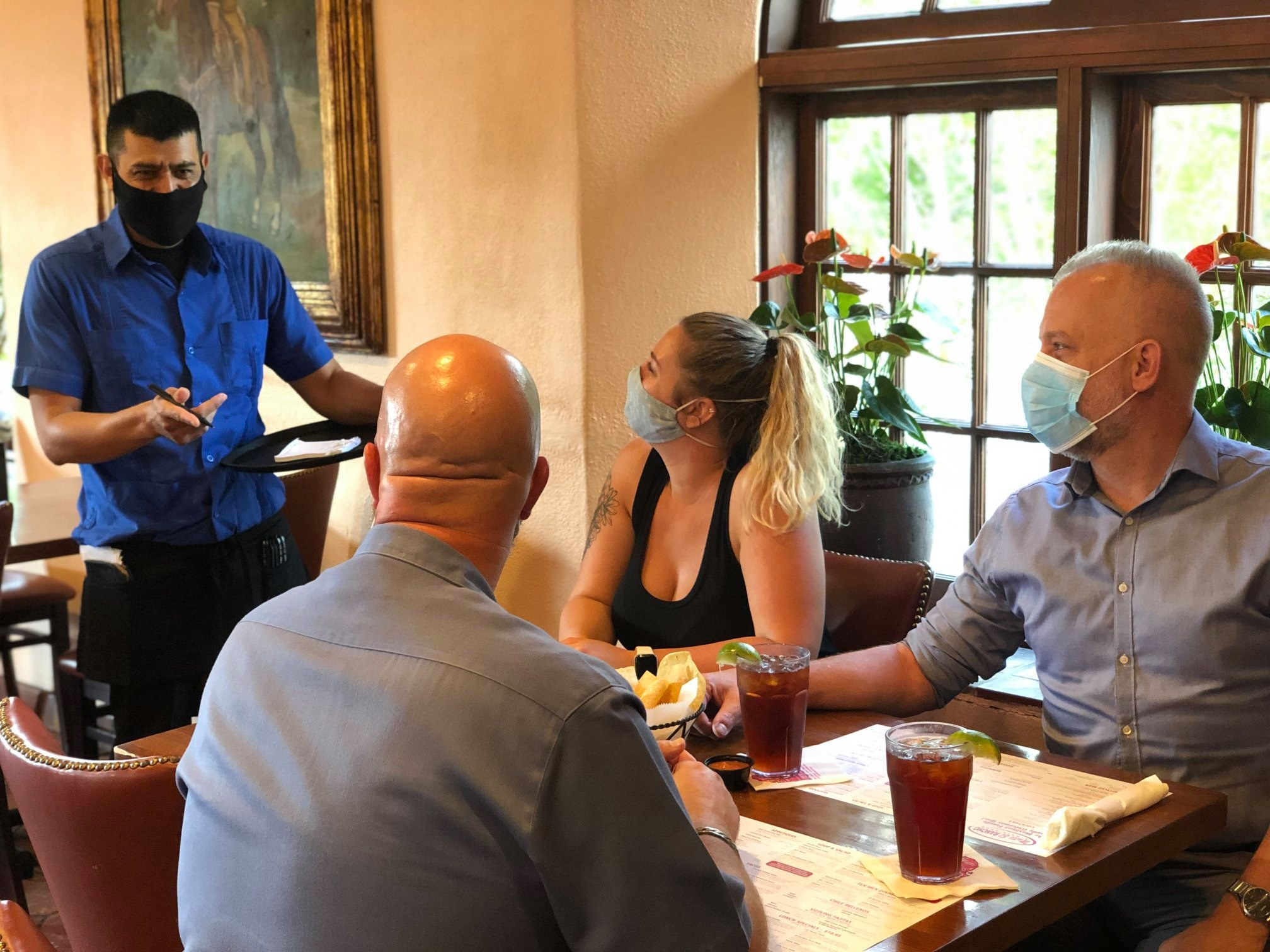 A server attending to a group dining at Matt's El Rancho