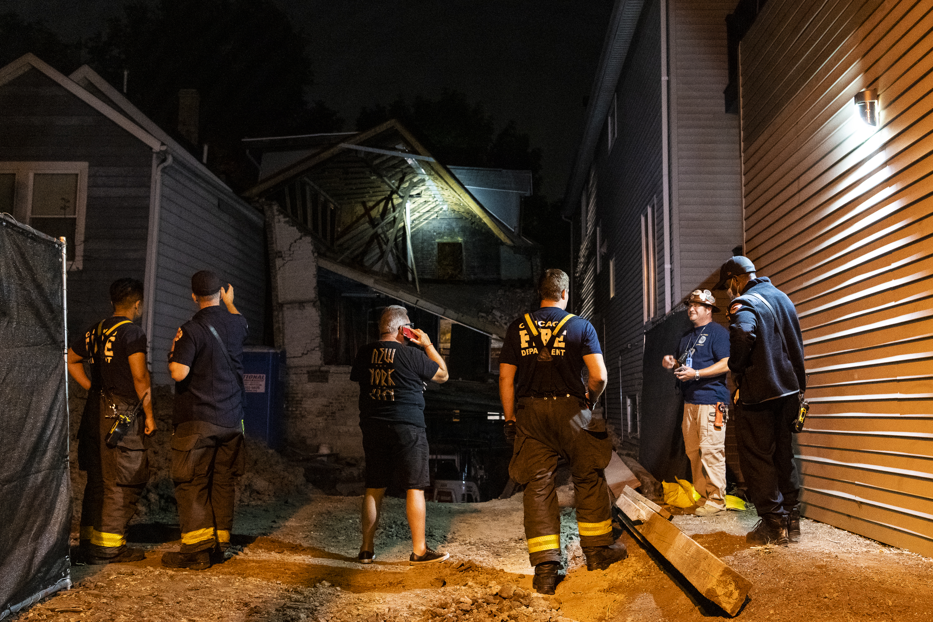 First responders work the scene of a building collapse in the 1000 block of North Marion, in the Wicker Park neighborhood, Tuesday, Sept. 22, 2020.