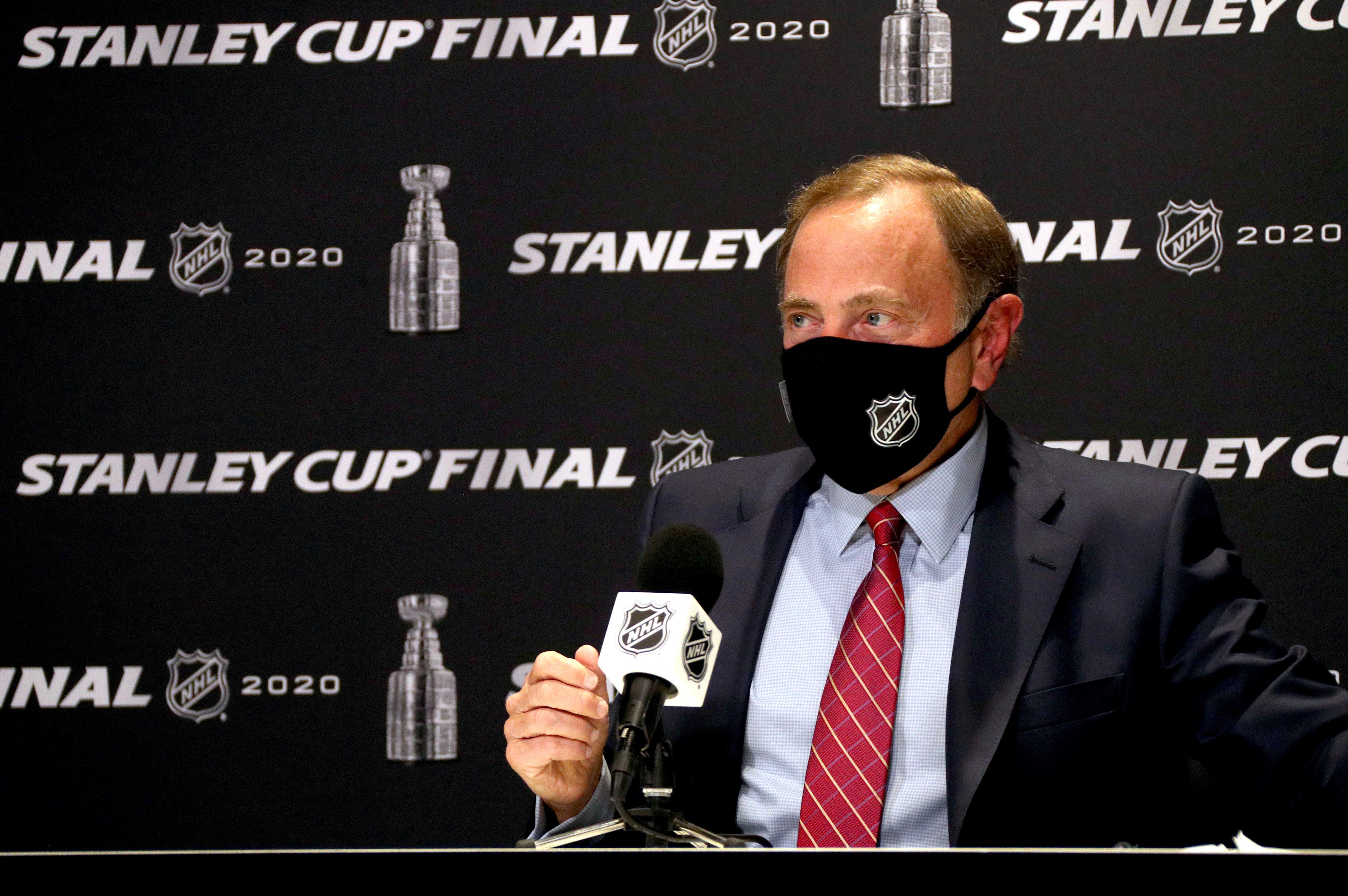 NHL Commissioner Gary Bettman attends a press conference wearing a mask before Game One of the NHL Stanley Cup Final between the Dallas Stars and the Tampa Bay Lightning at Rogers Place on September 19, 2020 in Edmonton, Alberta.