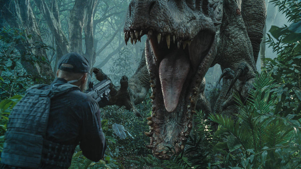"""The Indominus rex readies her attack in """"Jurassic World."""" Steven Spielberg returns to executive produce the long-awaited next installment of his groundbreaking """"Jurassic Park"""" series. Colin Trevorrow directs the epic action-adventure, and Frank Marshall a"""