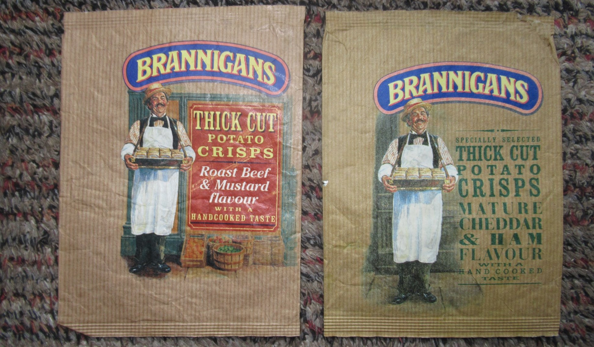 Two Brannigans crisp packets from the 1980s, depicting a jolly figure with the flavours roast beef and mustard and mature cheddar and ham