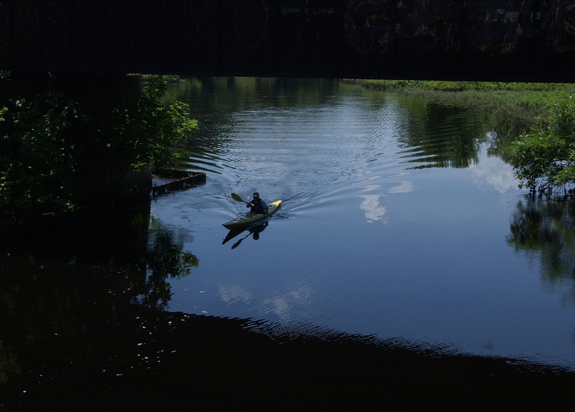 A lone kayaker paddles along the calm waters of the Sudbury River in Concord, Mass., Wednesday, July 2, 2003.
