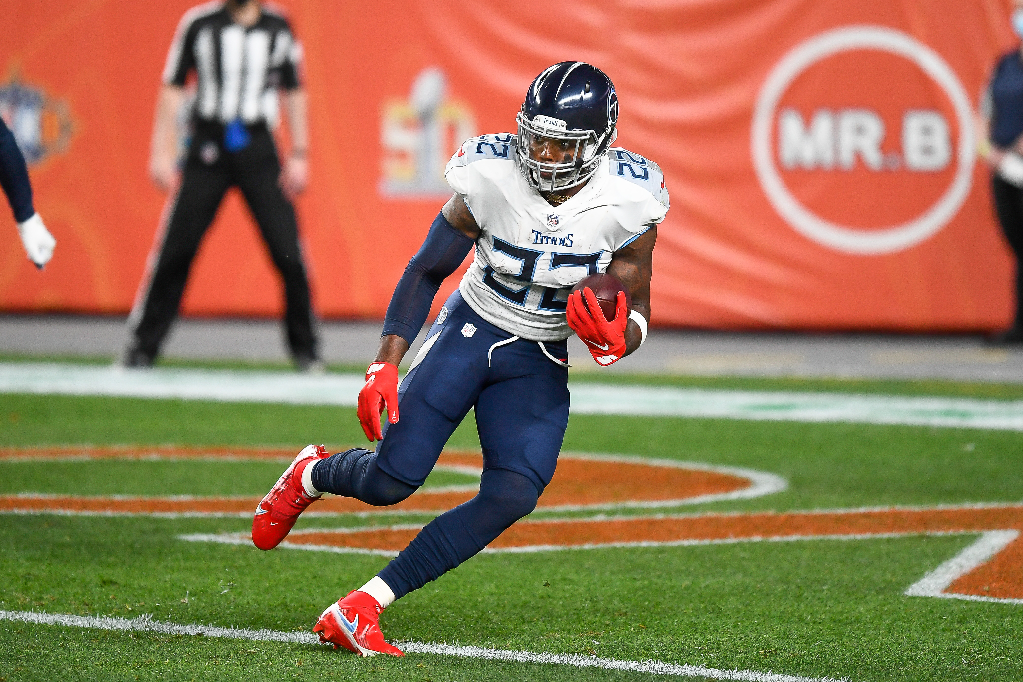 Derrick Henry of the Tennessee Titans carries the ball against the Denver Broncos at Empower Field at Mile High on September 14, 2020 in Denver, Colorado.
