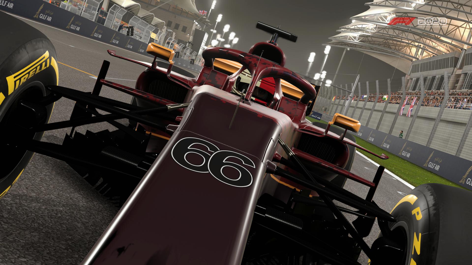 tilt-frame shot of a Formula 1 car racing into the foreground at Bahrain International Circuit, Sakhir