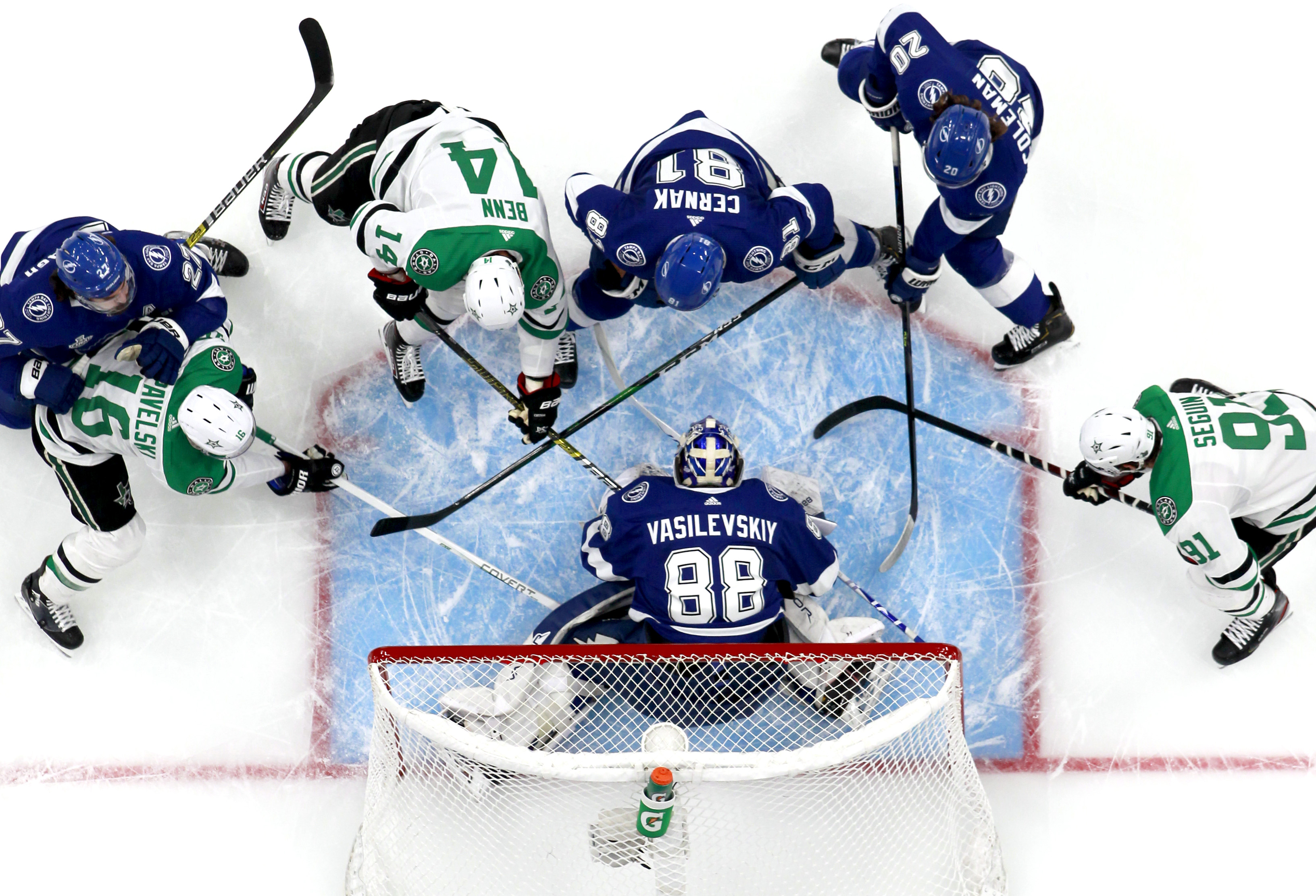 Goaltender Andrei Vasilevskiy of the Tampa Bay Lightning makes a save against Jamie Benn and Joe Pavelski of the Dallas Stars as defenseman Erik Cernak  helps defend the play in the first period of Game 2 of the NHL Stanley Cup Final at Rogers Place on September 21, 2020 in Edmonton, Alberta, Canada.