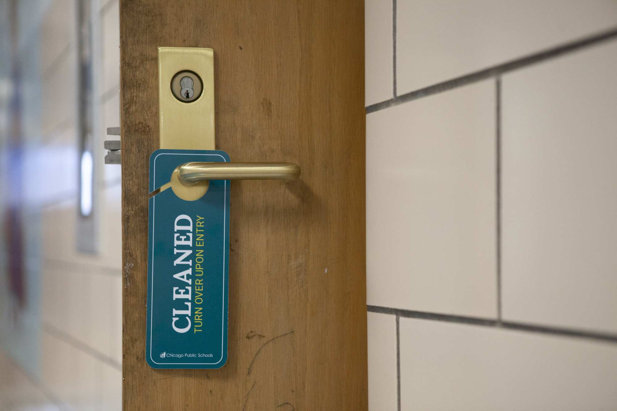 A sign hanging on a doorknob that indicates that the room has recently been cleaned.