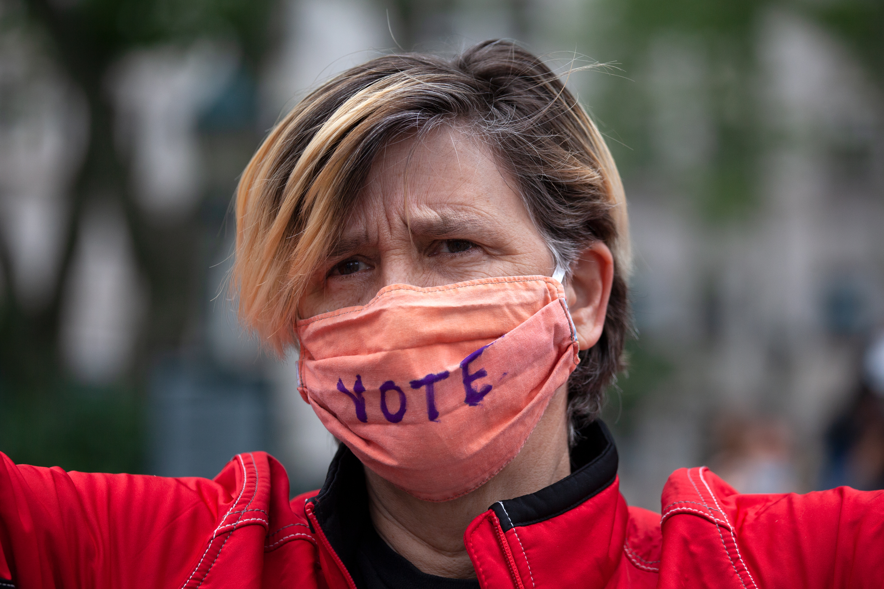 """A protester wears a """"vote"""" mask in Foley Square, June 2, 2020."""