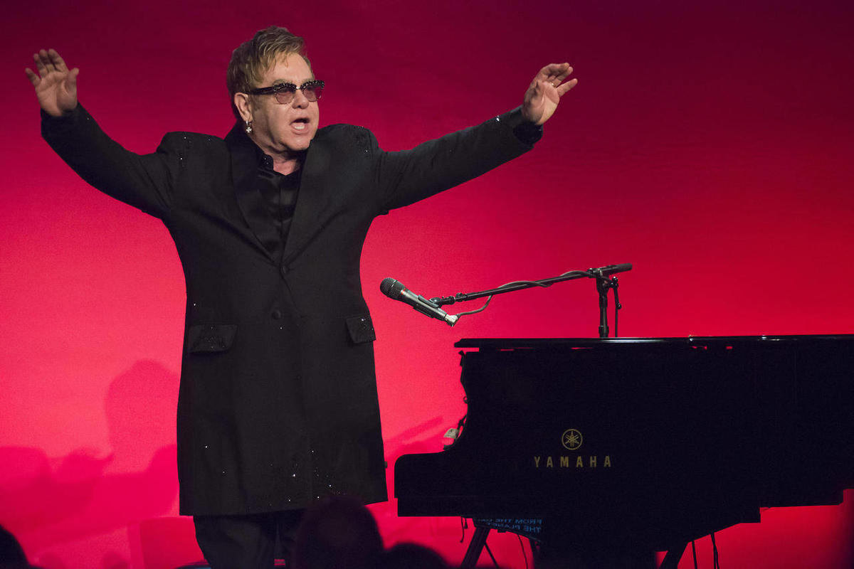 """Elton John performs at the Elton John AIDS Foundation's 13th Annual """"An Enduring Vision"""" benefit at Cipriani's Wall Street on Tuesday, Oct. 28, 2014, in New York."""